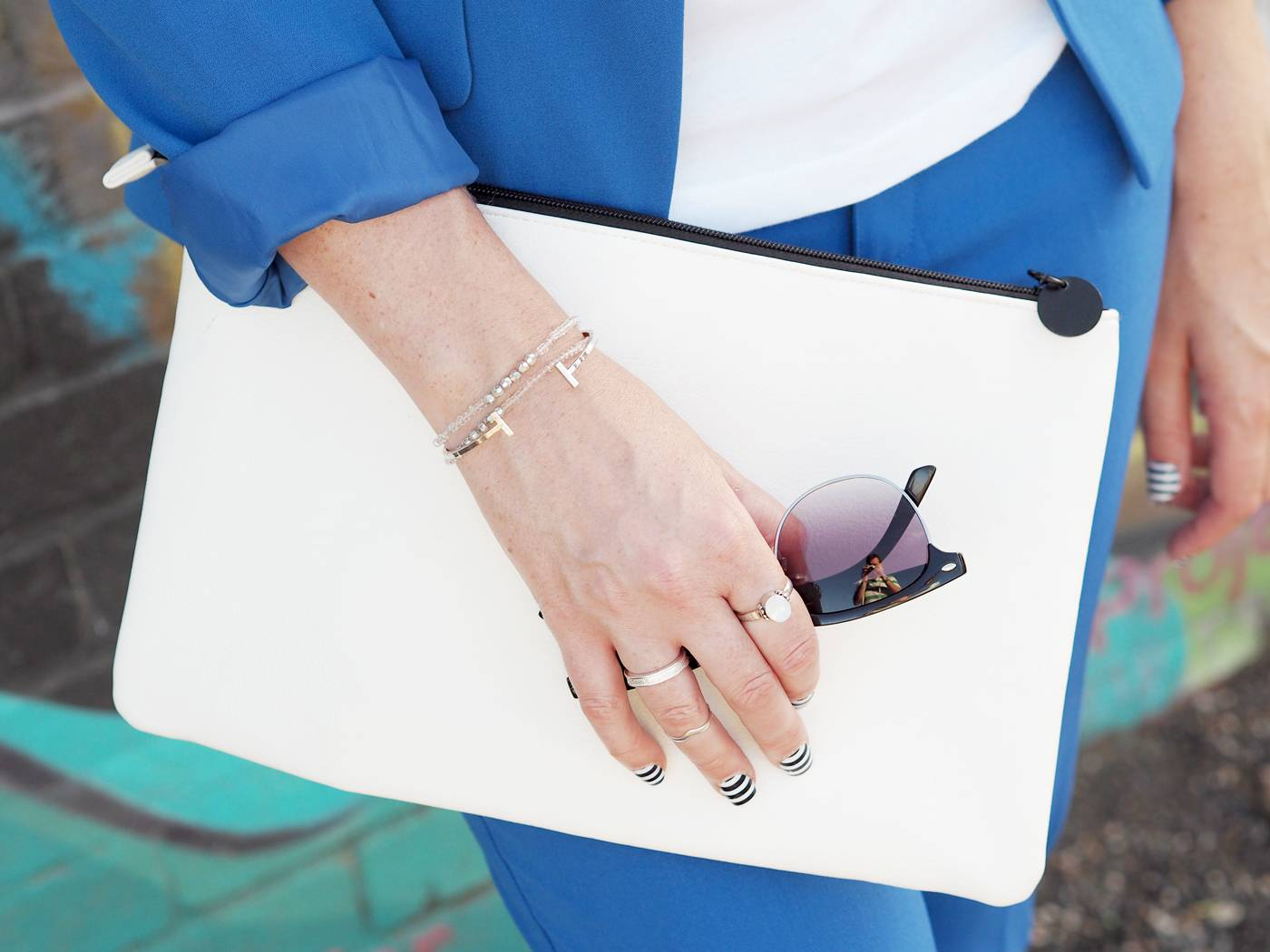 white clutch bag with striped nails