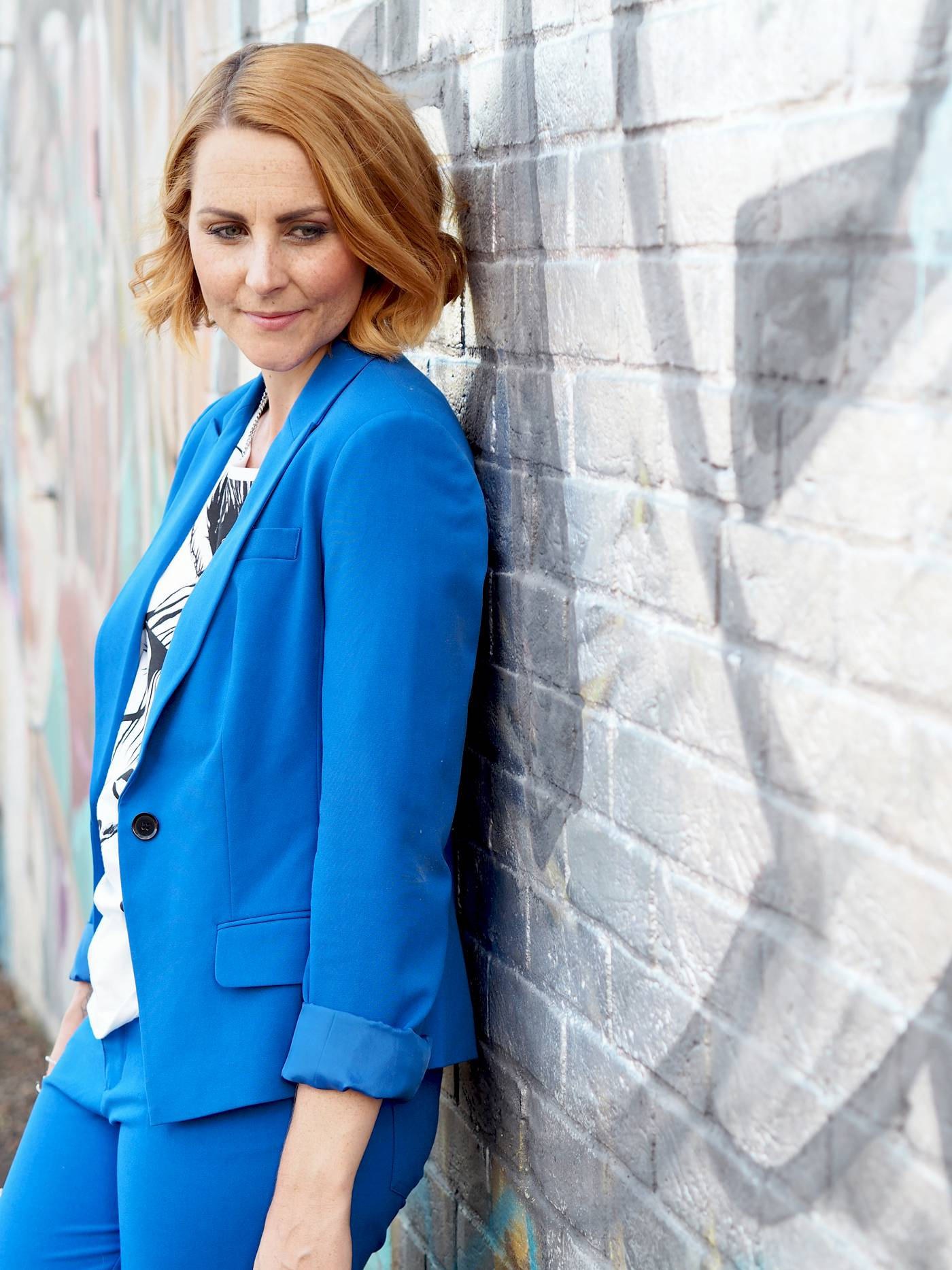 blue trouser suit with graphic tshirt