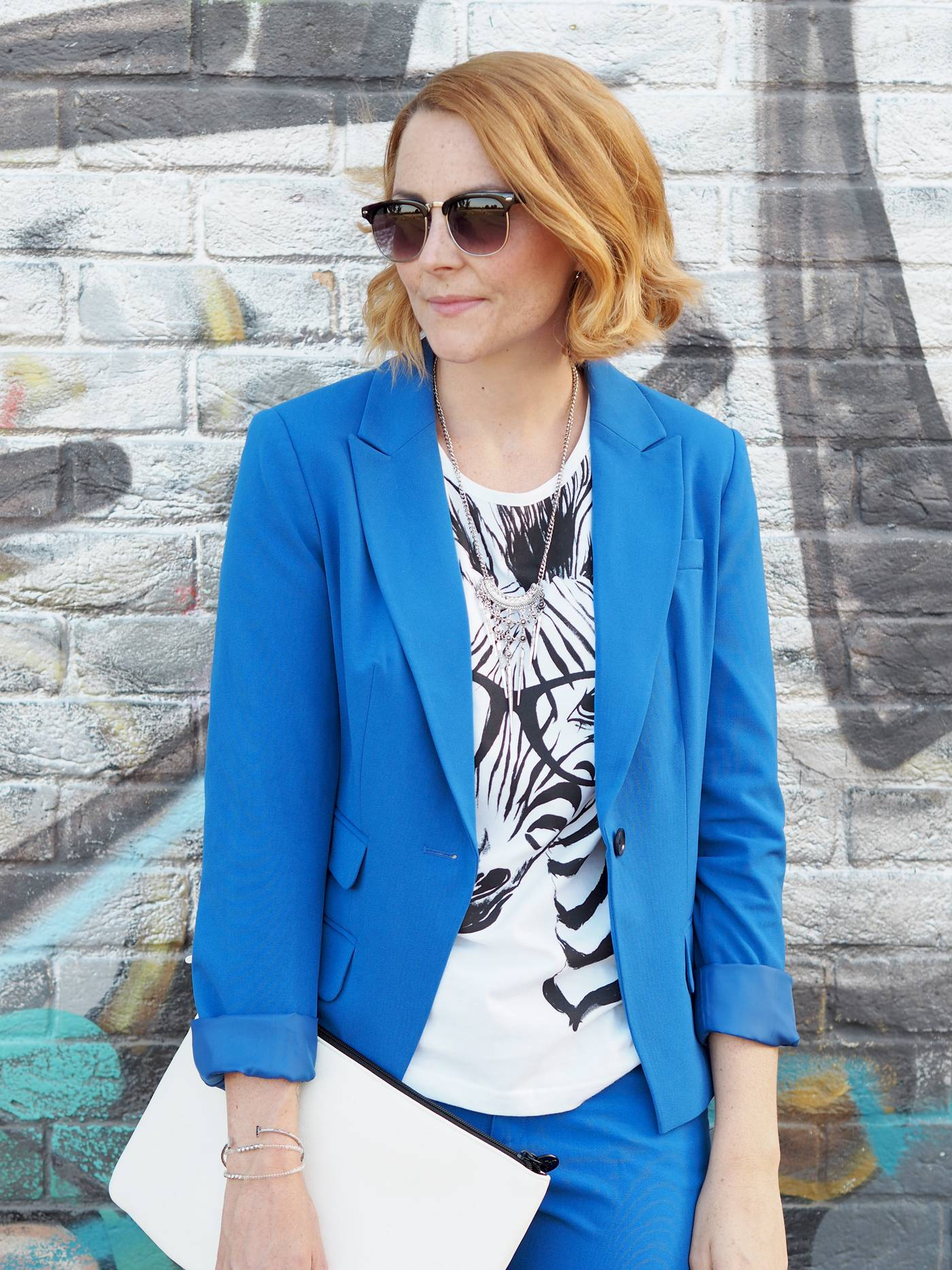 blue suit with monochrome tshirt