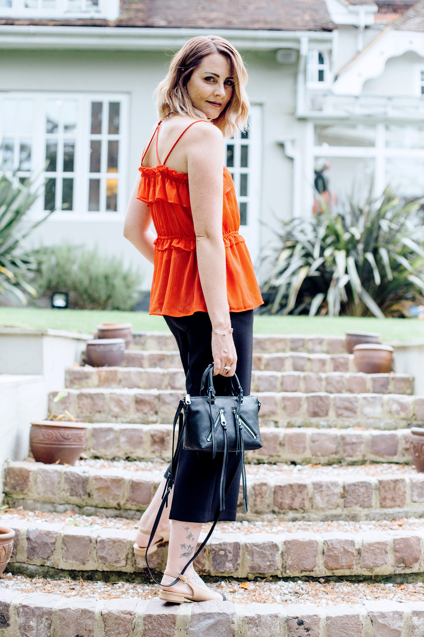 red frill top and black culottes outfit