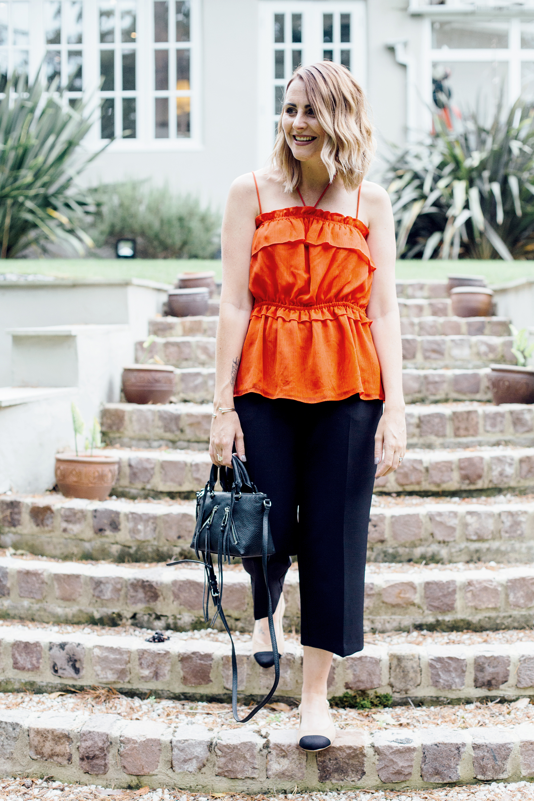 red top and black culottes outfit