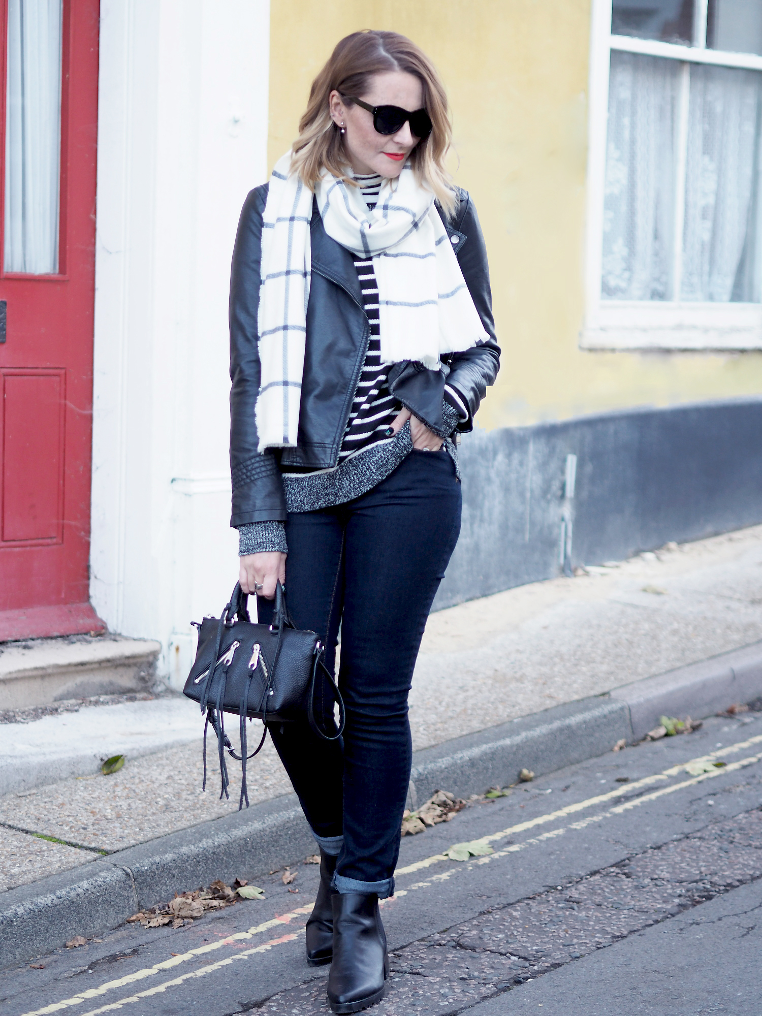 black and white striped jumper and check scarf