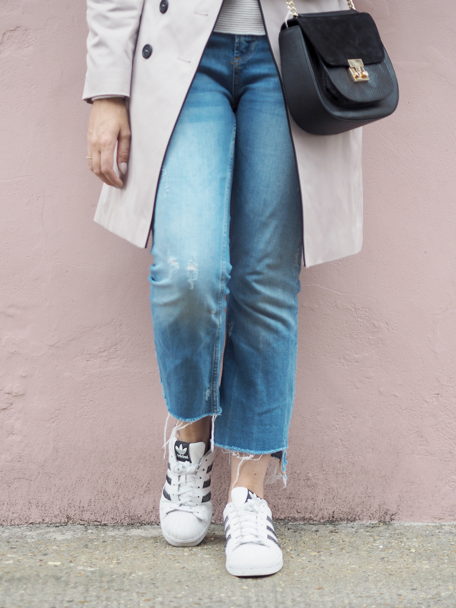 denim and Adidas trainers