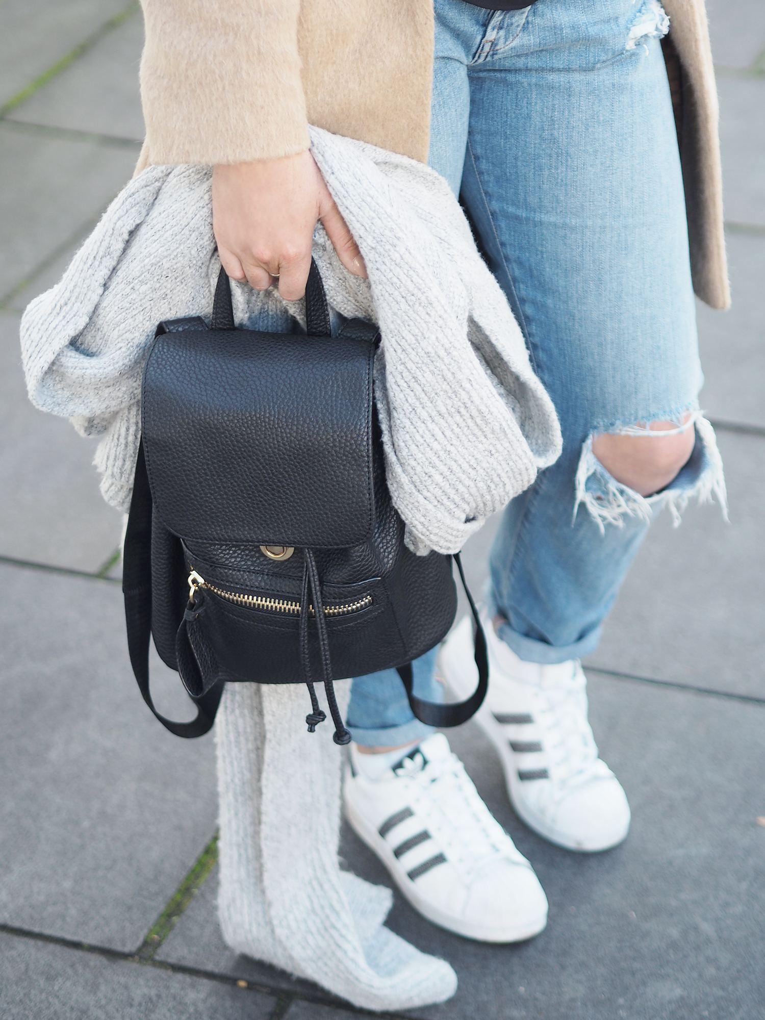 black mini rucksack and addidas