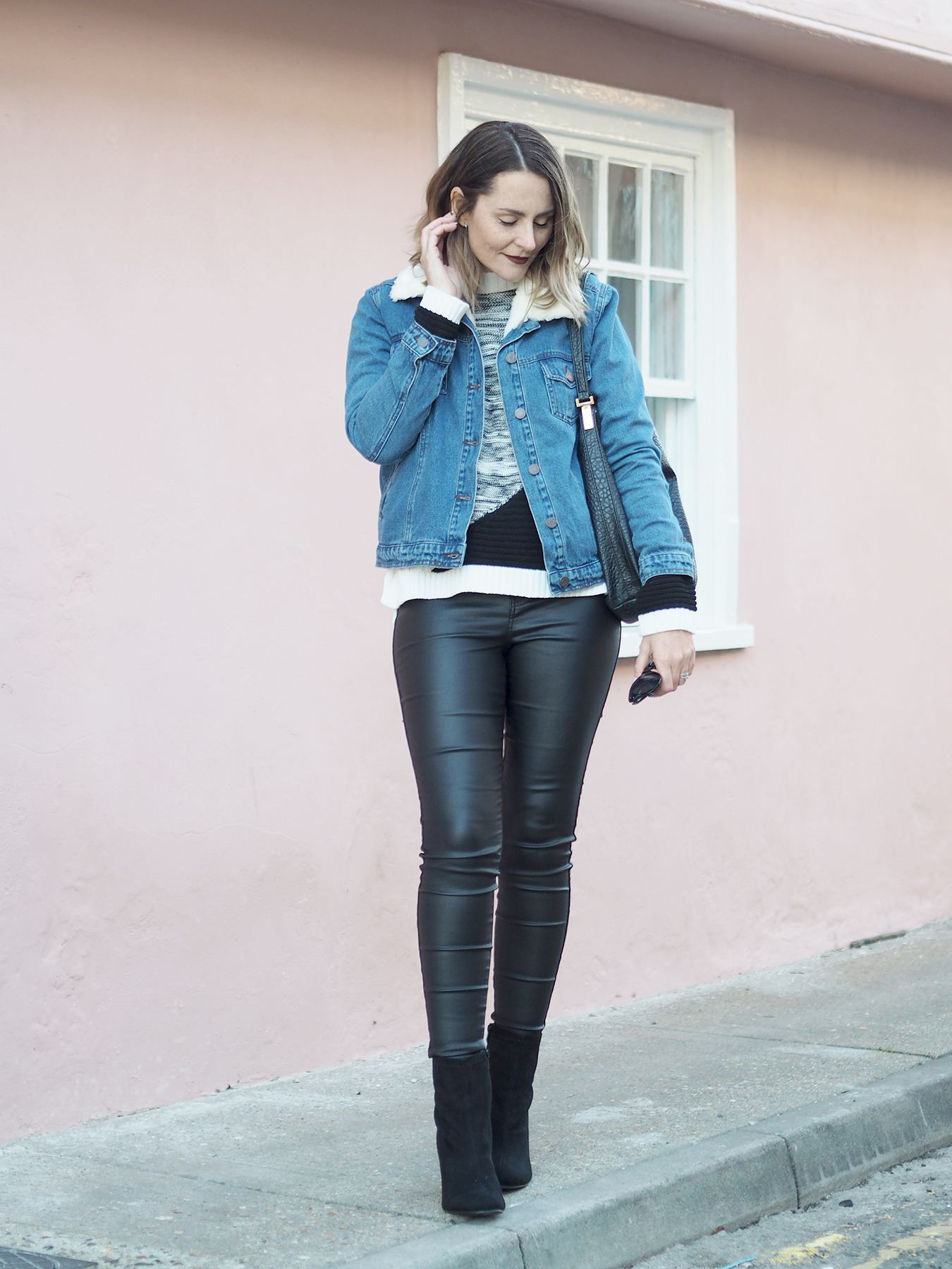 leather look jeans and boots outfit with denim jacket