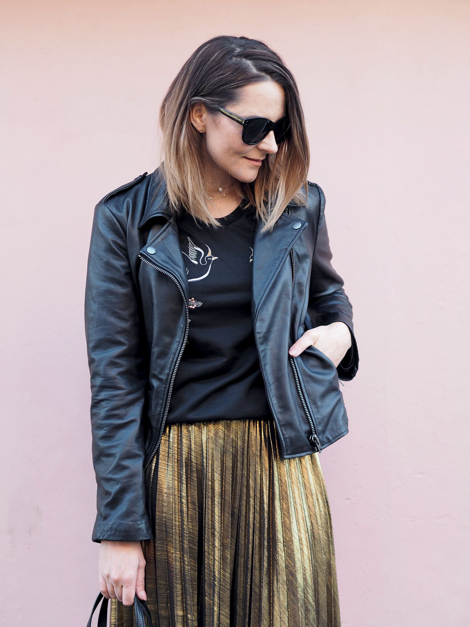 pleated midi skirt outfit gold skirt with biker jacket