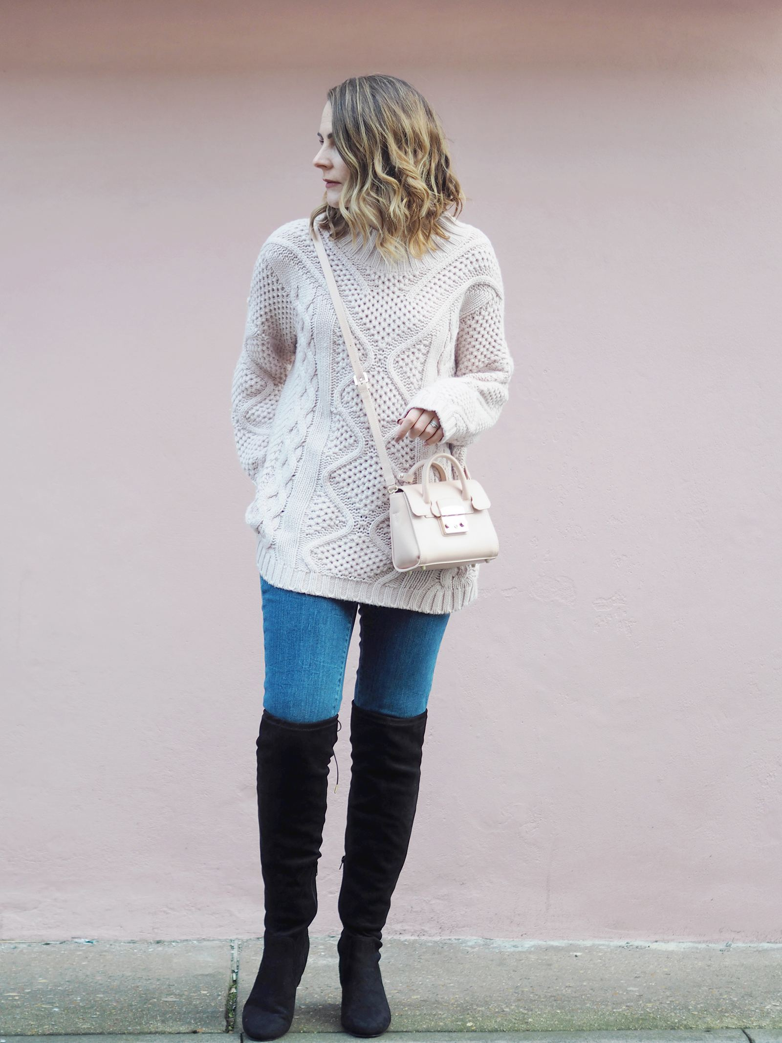pink chunky knit outfit with knee high boots