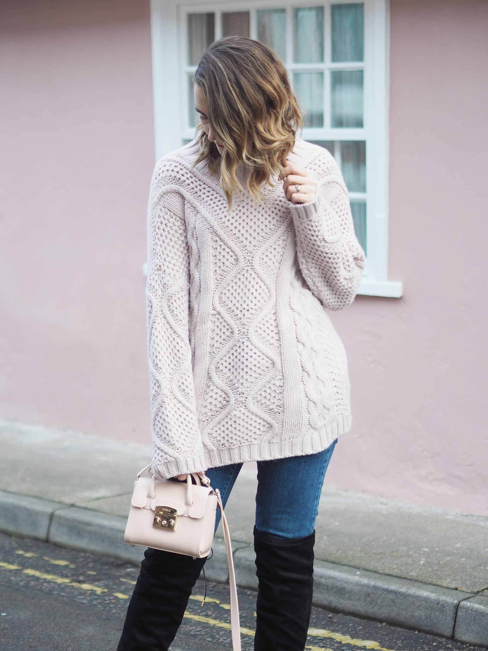 pink chunky jumper outfit with knee high boots