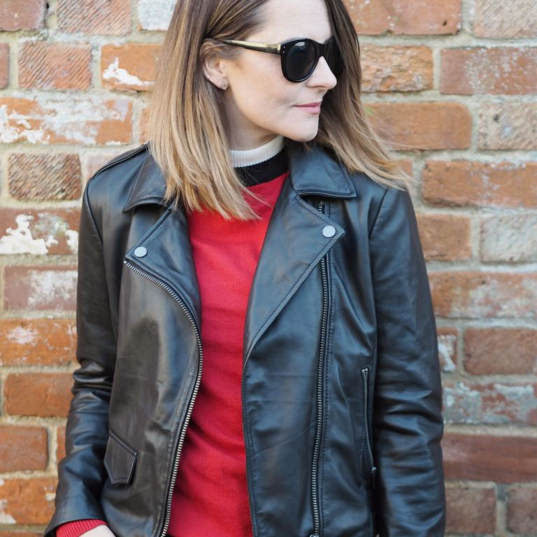 sporty striped outfit black biker jacket and red jumper