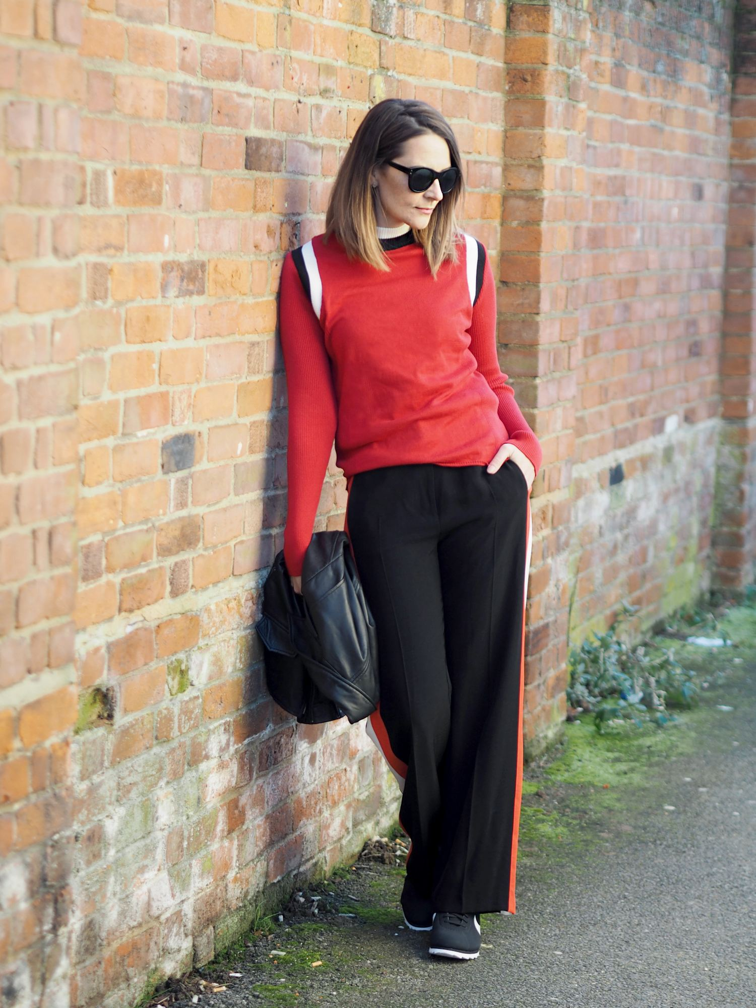 Sports Luxe Trend red jumper and striped wide leg trouser outfit