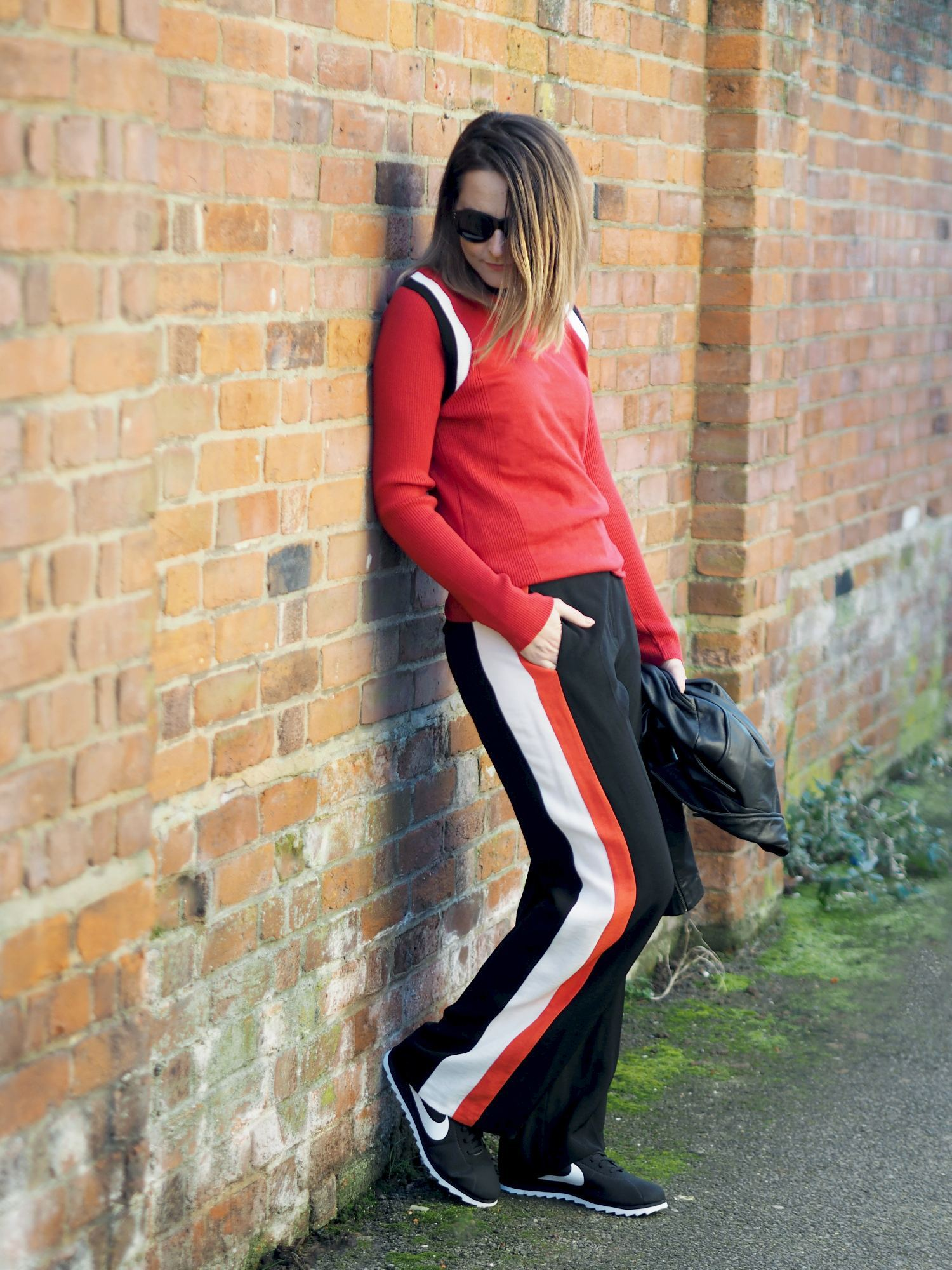Sports Luxe Trend striped wide leg trousers outfit with red jumper sporty outfit