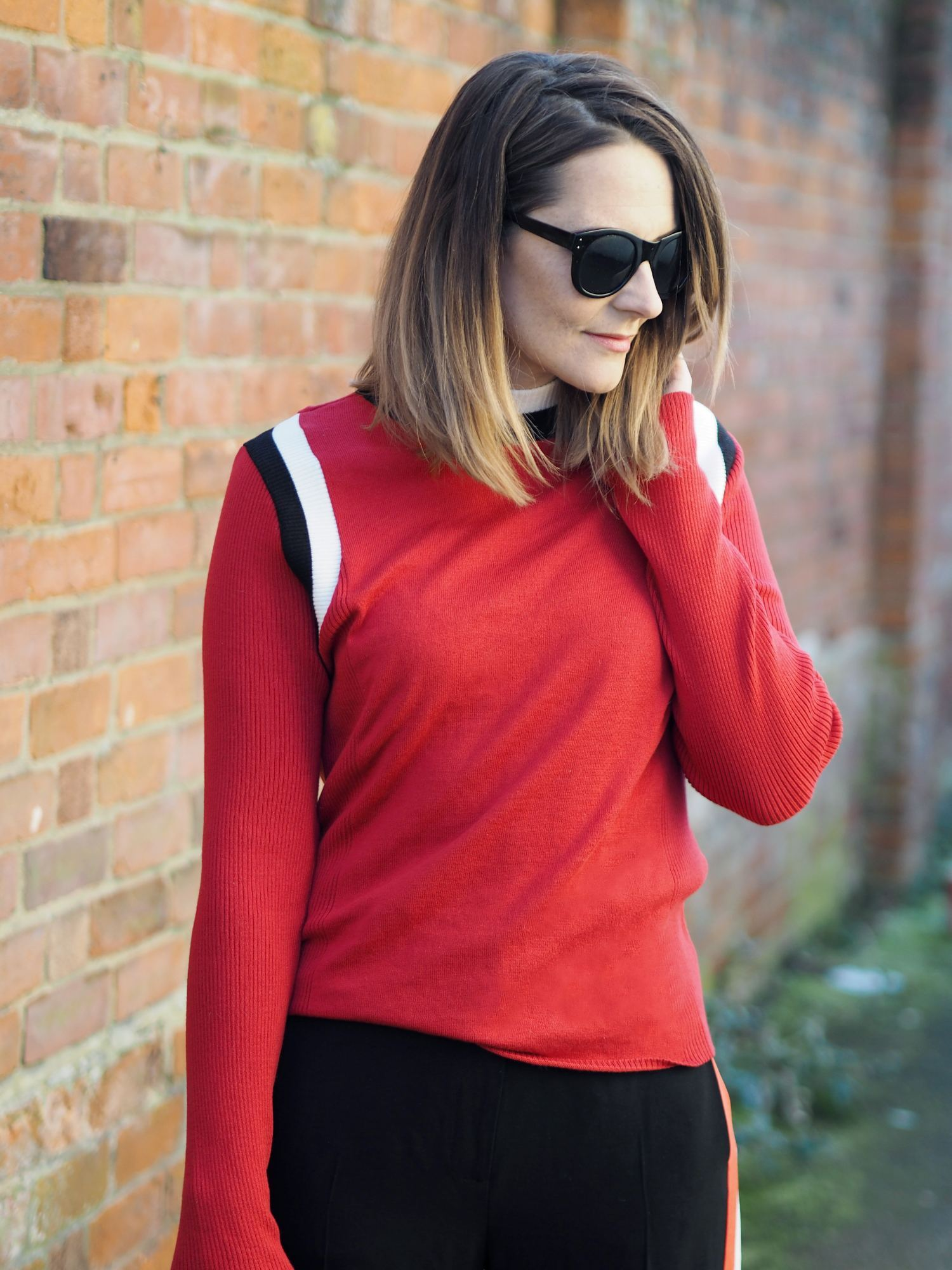 striped wide leg trousers outfit with red jumper sporty outfit