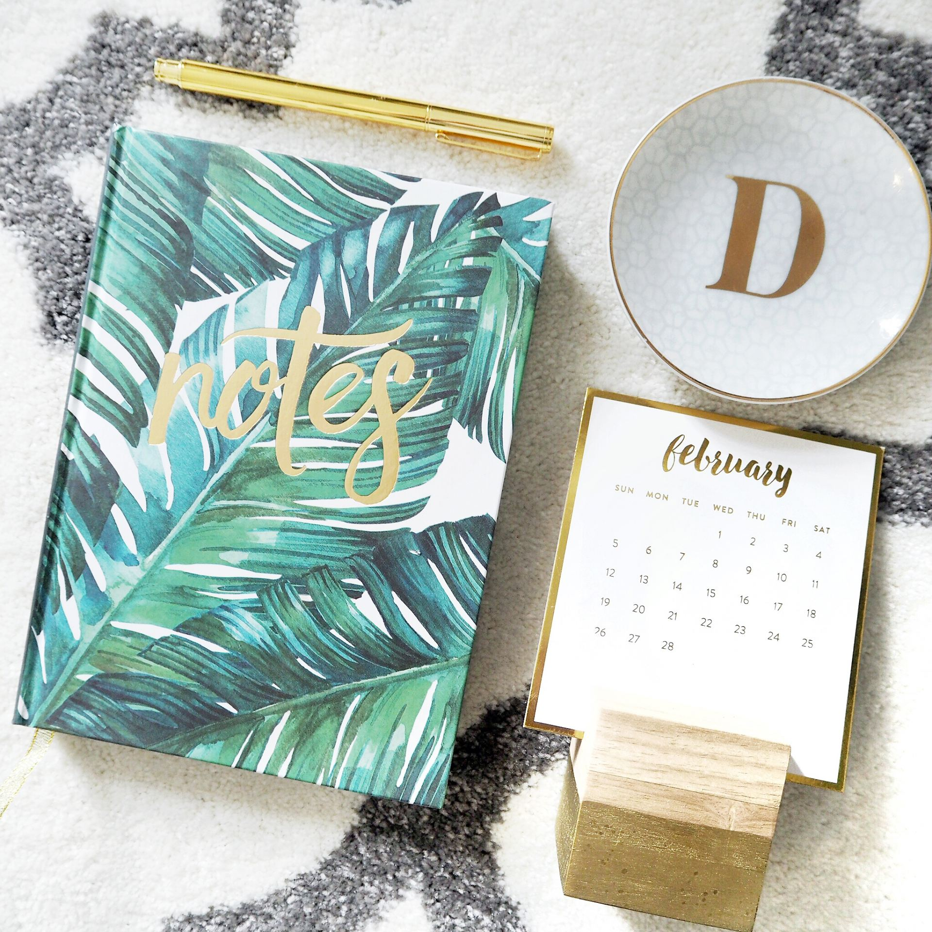 palm leaf notebook and gold jewellery tray