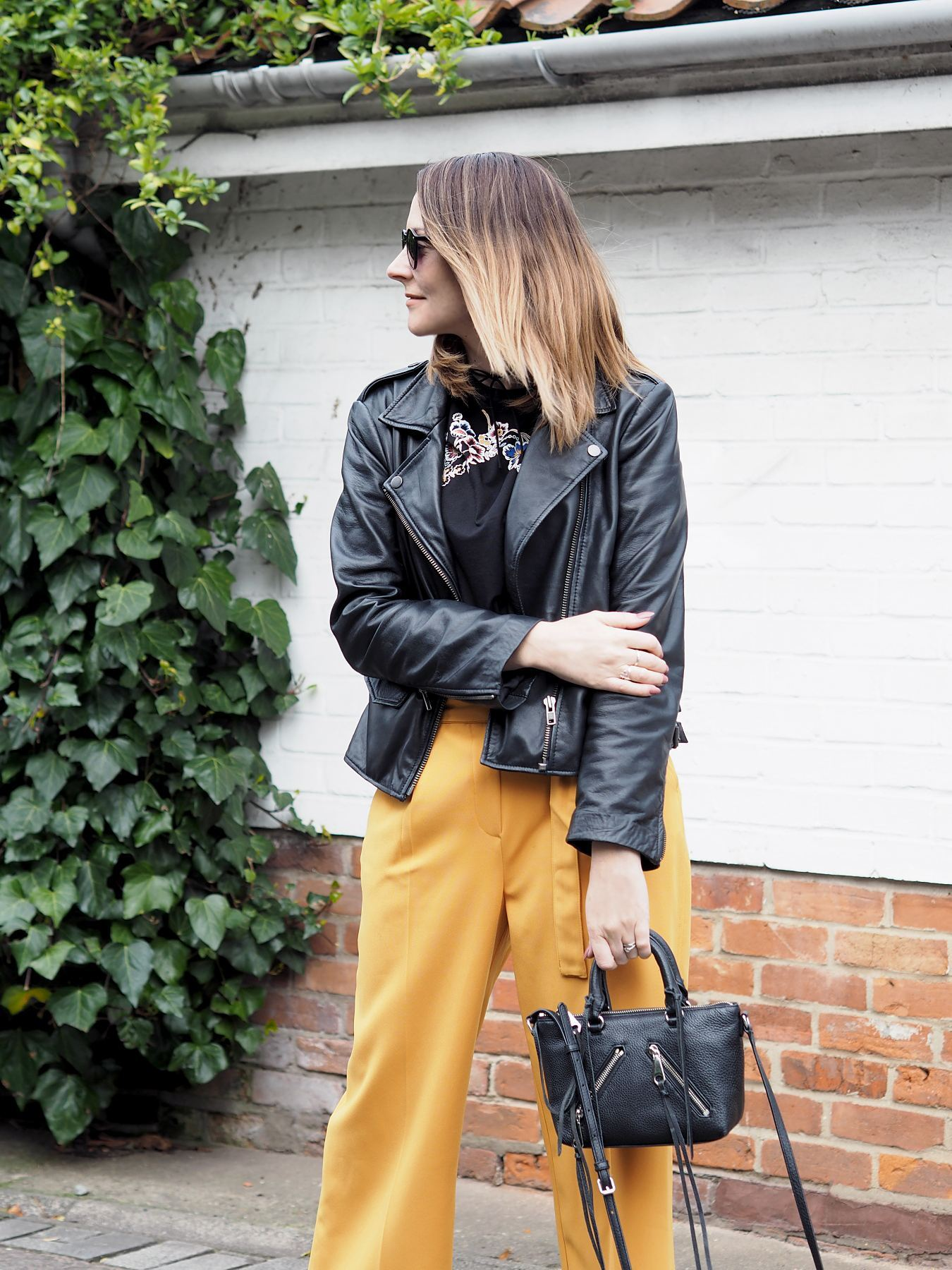m&s limited collection floral tshirt biker jacket and yellow trousers outfit