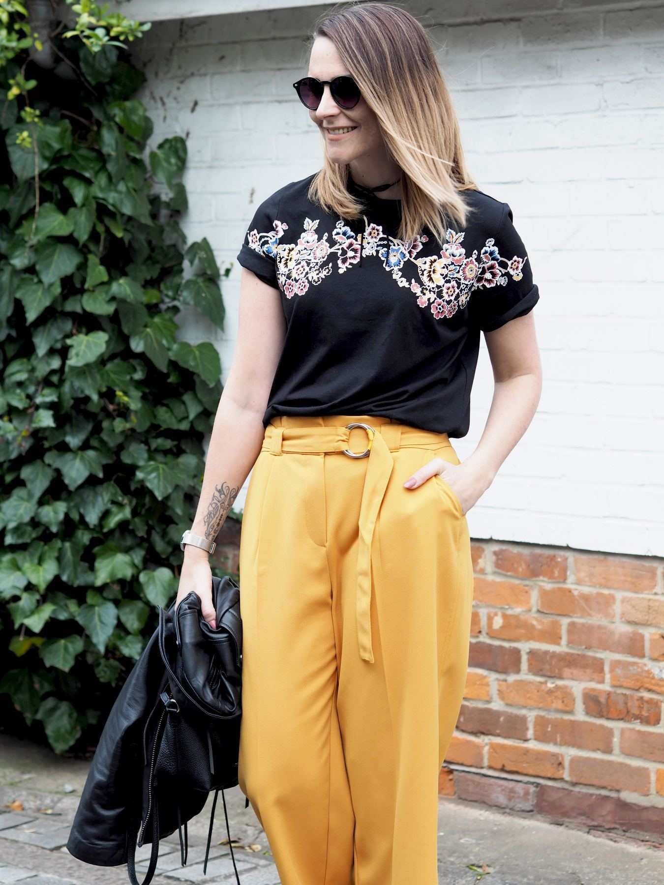 new look trousers and floral tshirt
