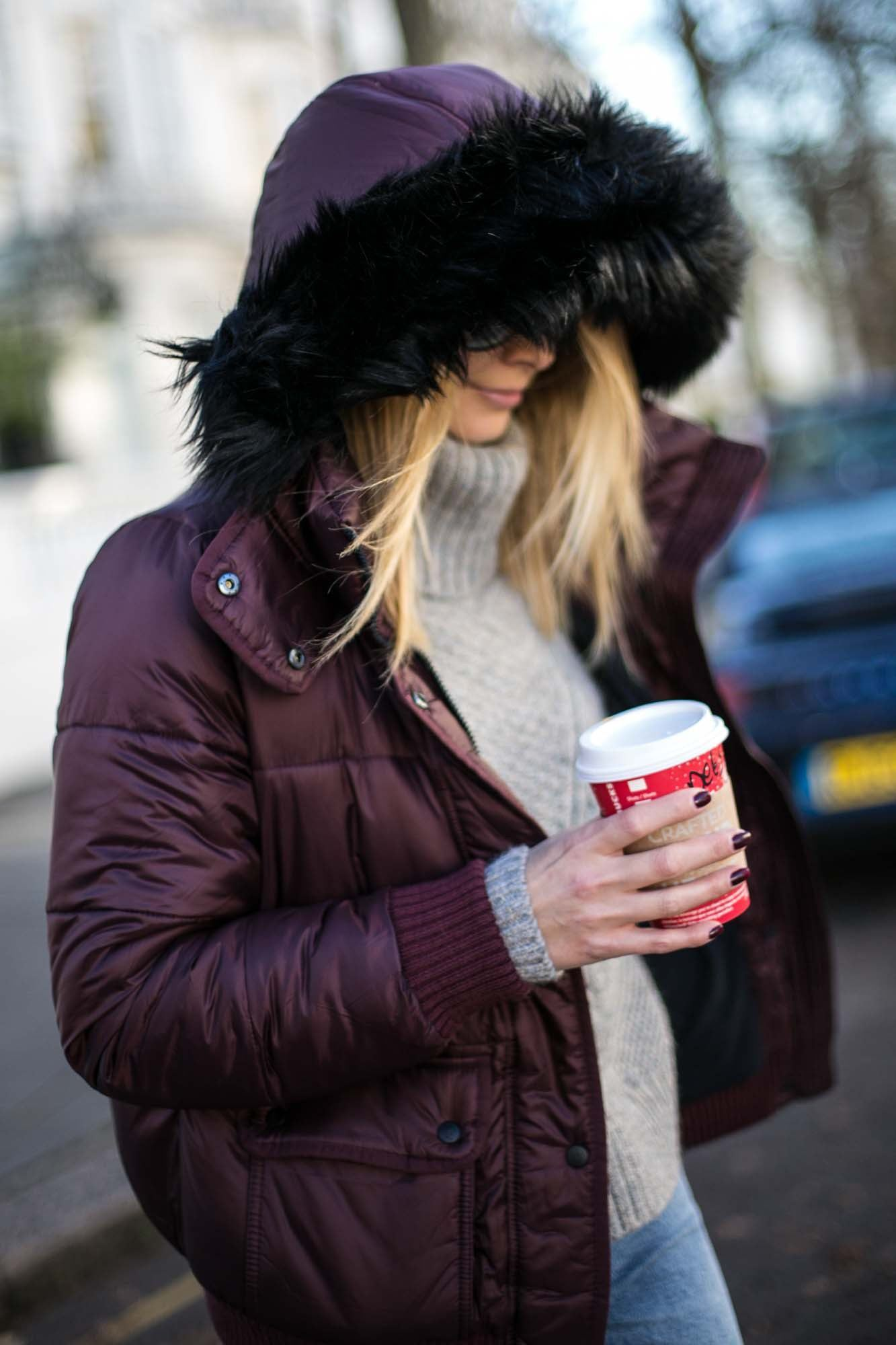 emma hill in puffer jacket and coffee