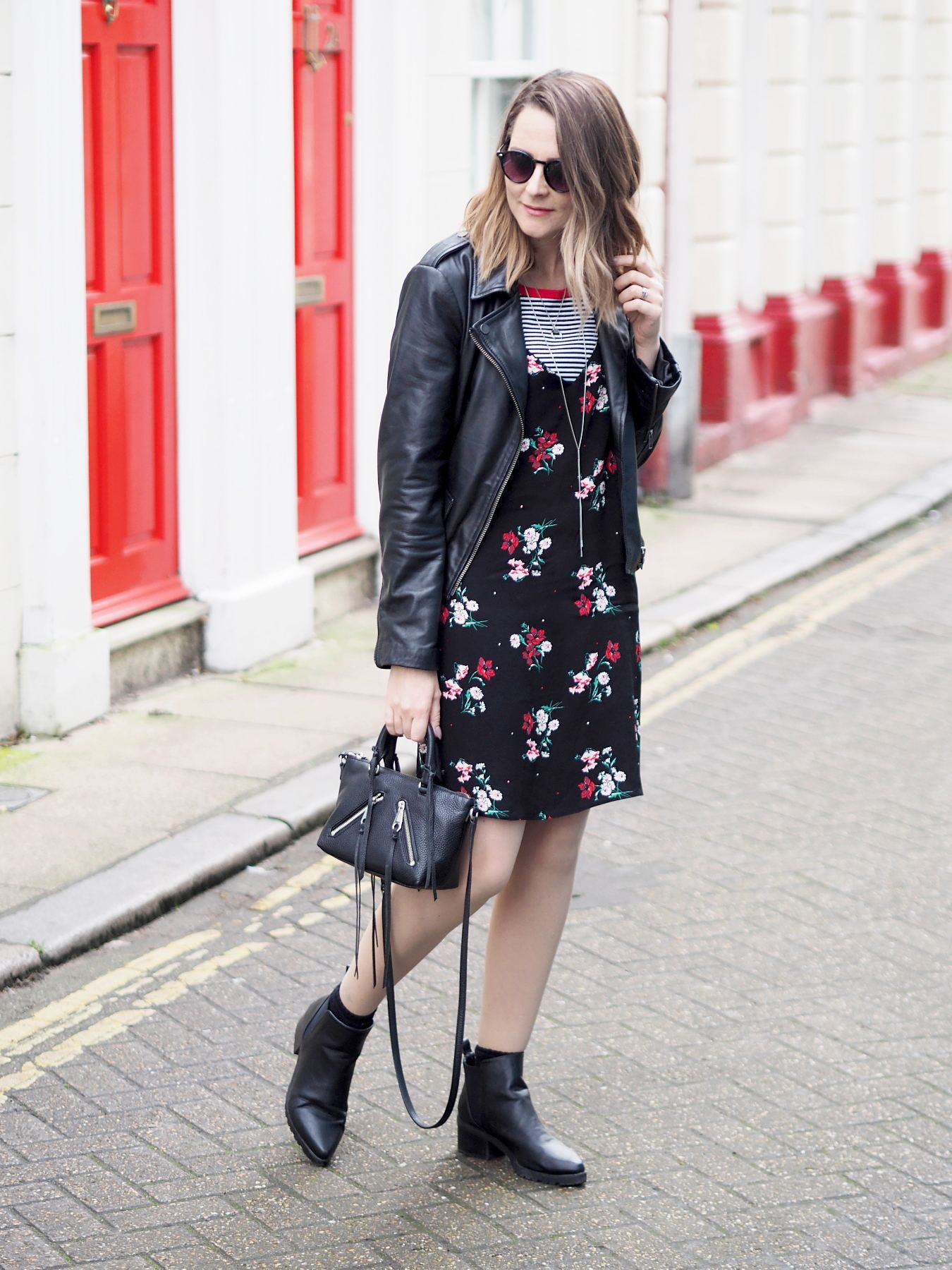 new look floral slip dress with striped tshirt and black biker jacket outfit summer