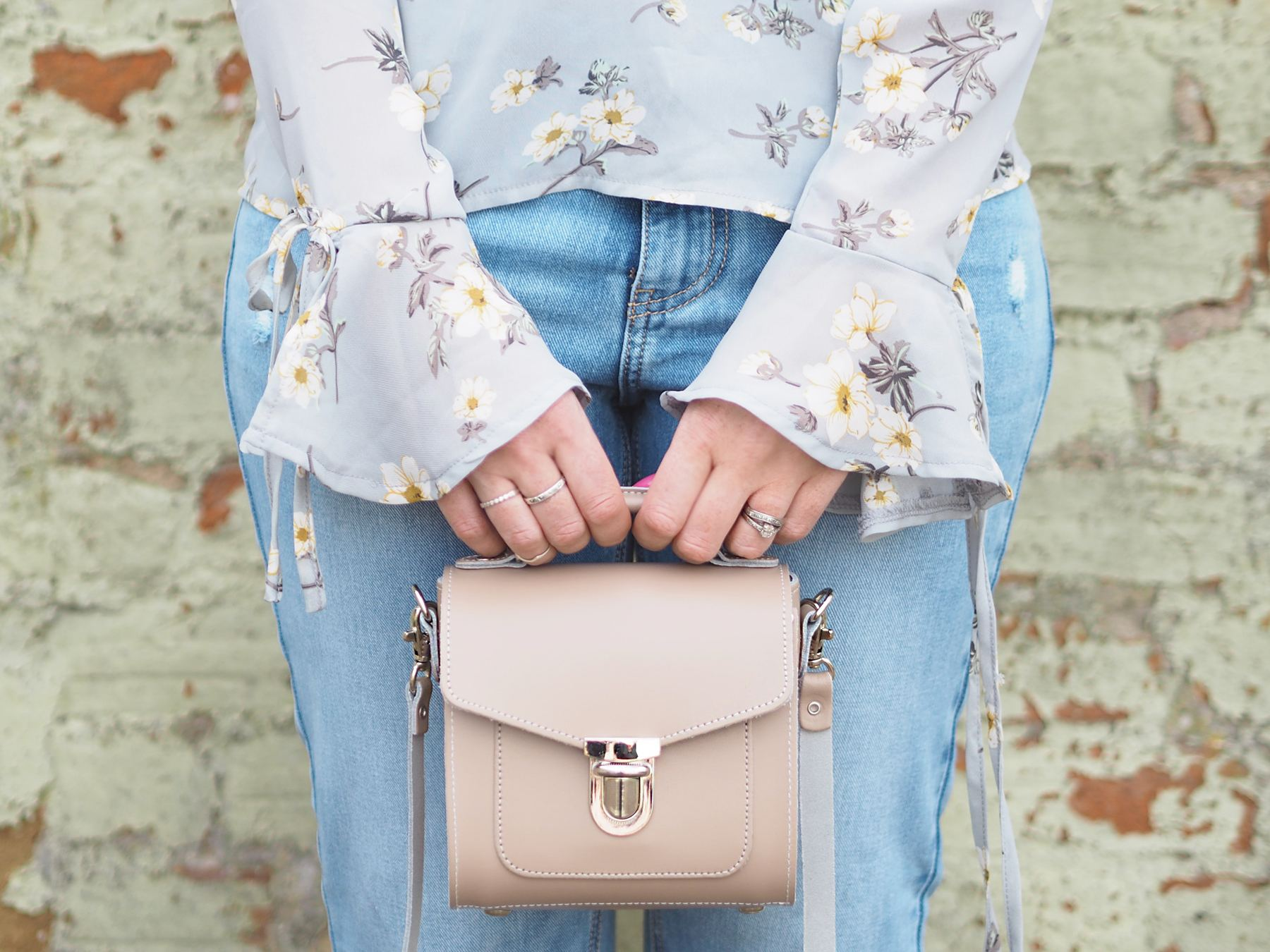 missguided floral blouse fluted sleeves and zatchel handbag
