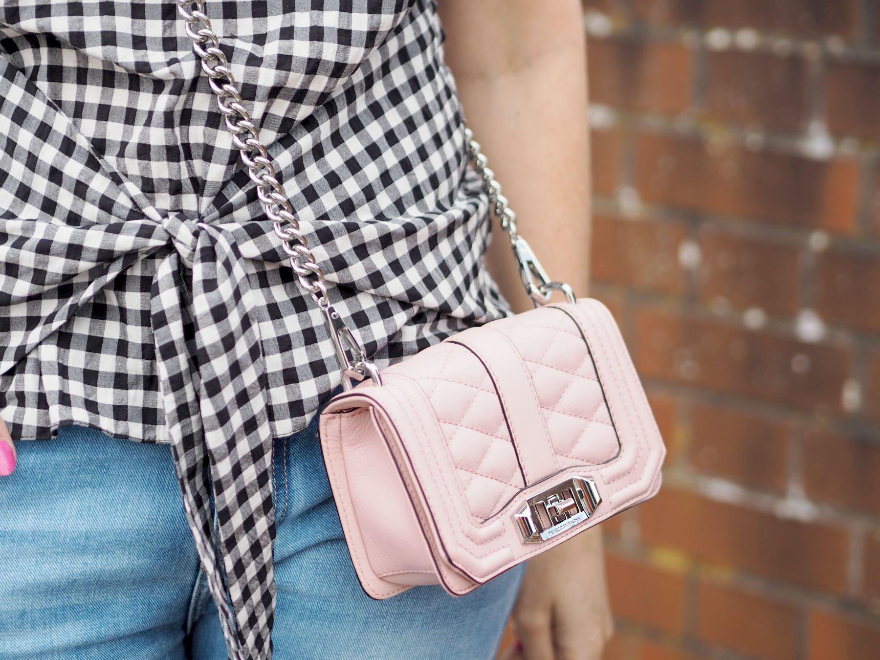 gingham top and pink handbag