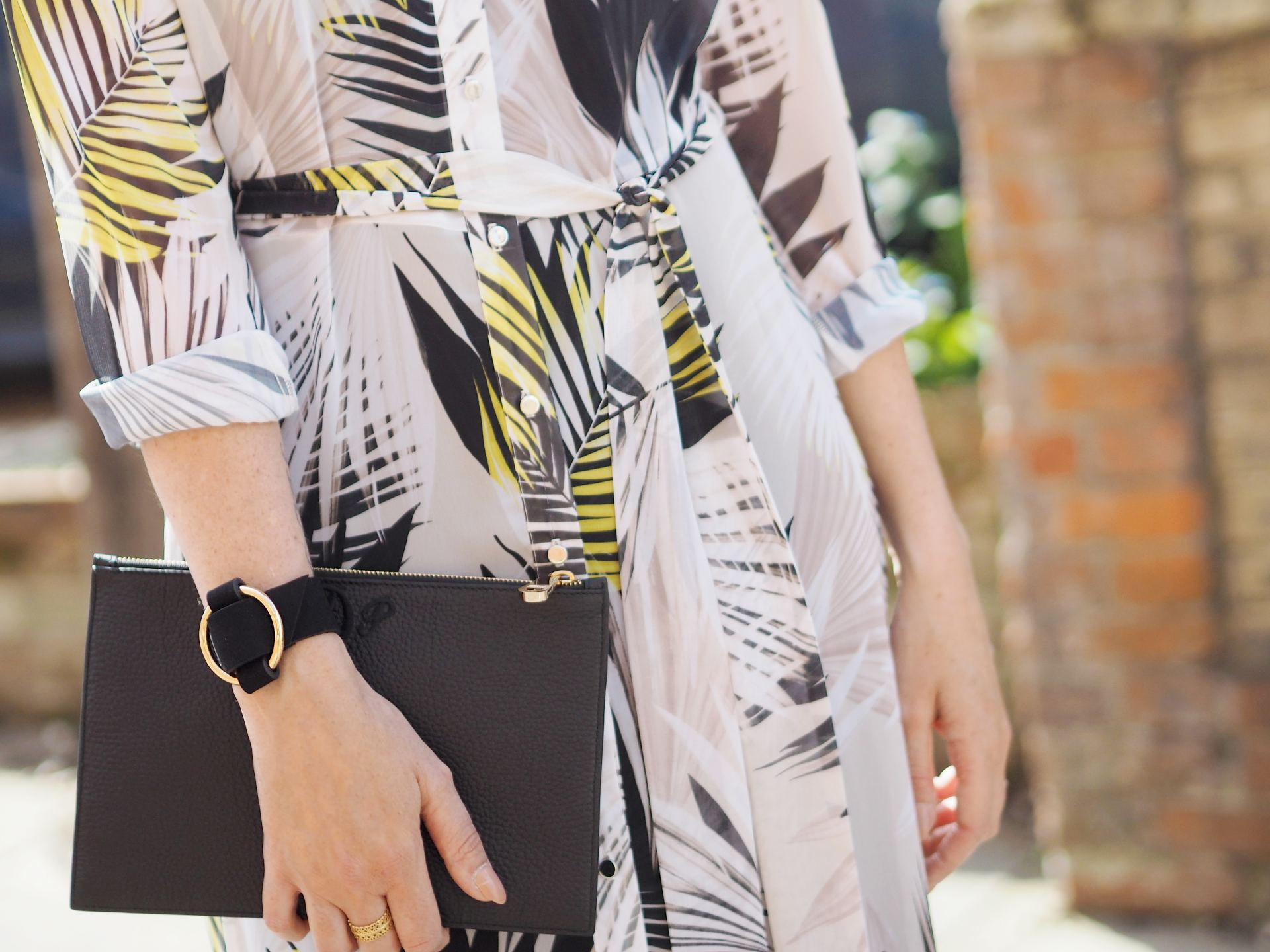leaf print wallis shirt dress with black clutch bag and cuff bracelet