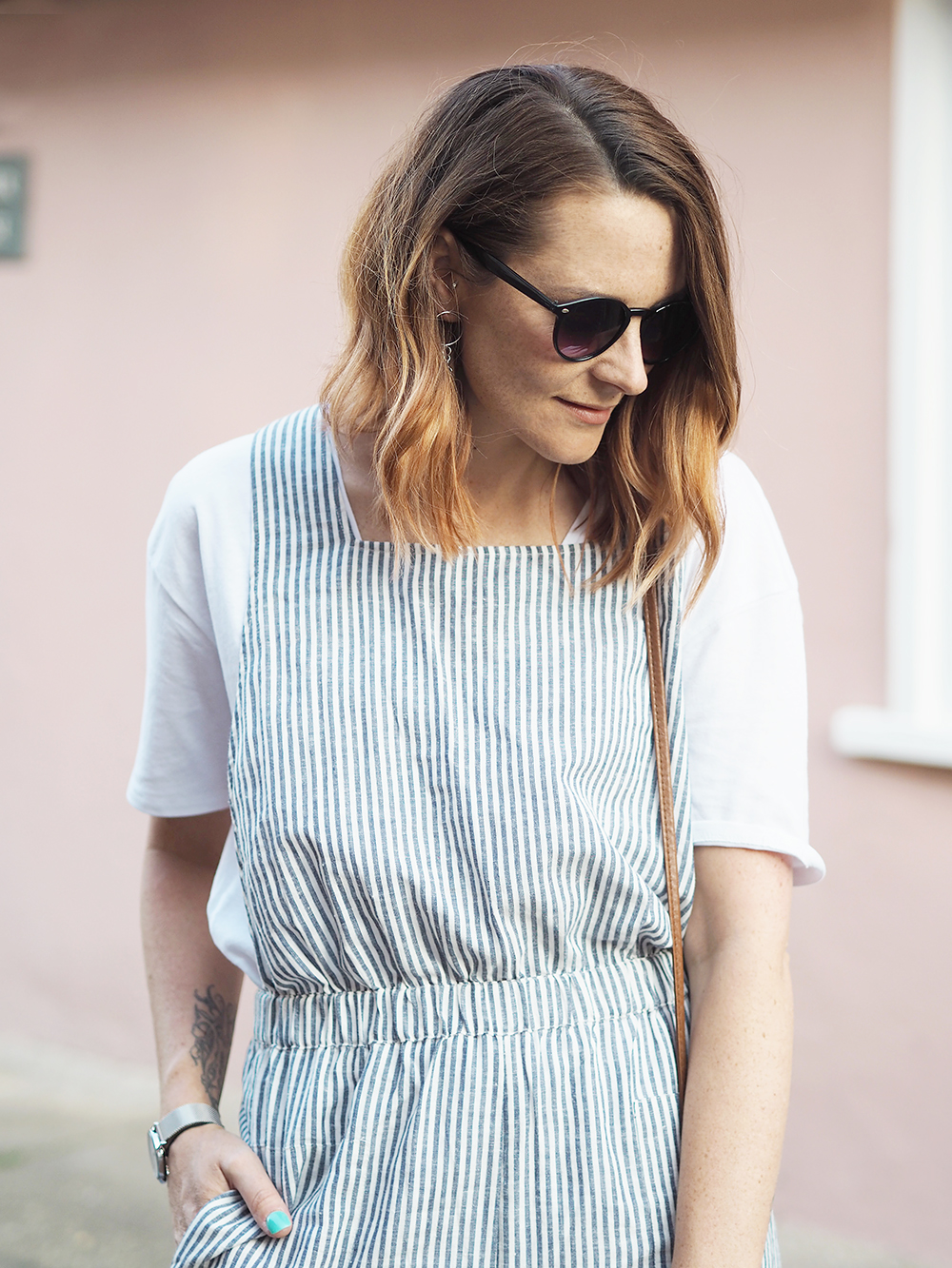 la Redoute striped jumpsuit casual summer outfit with trainers and straw bag