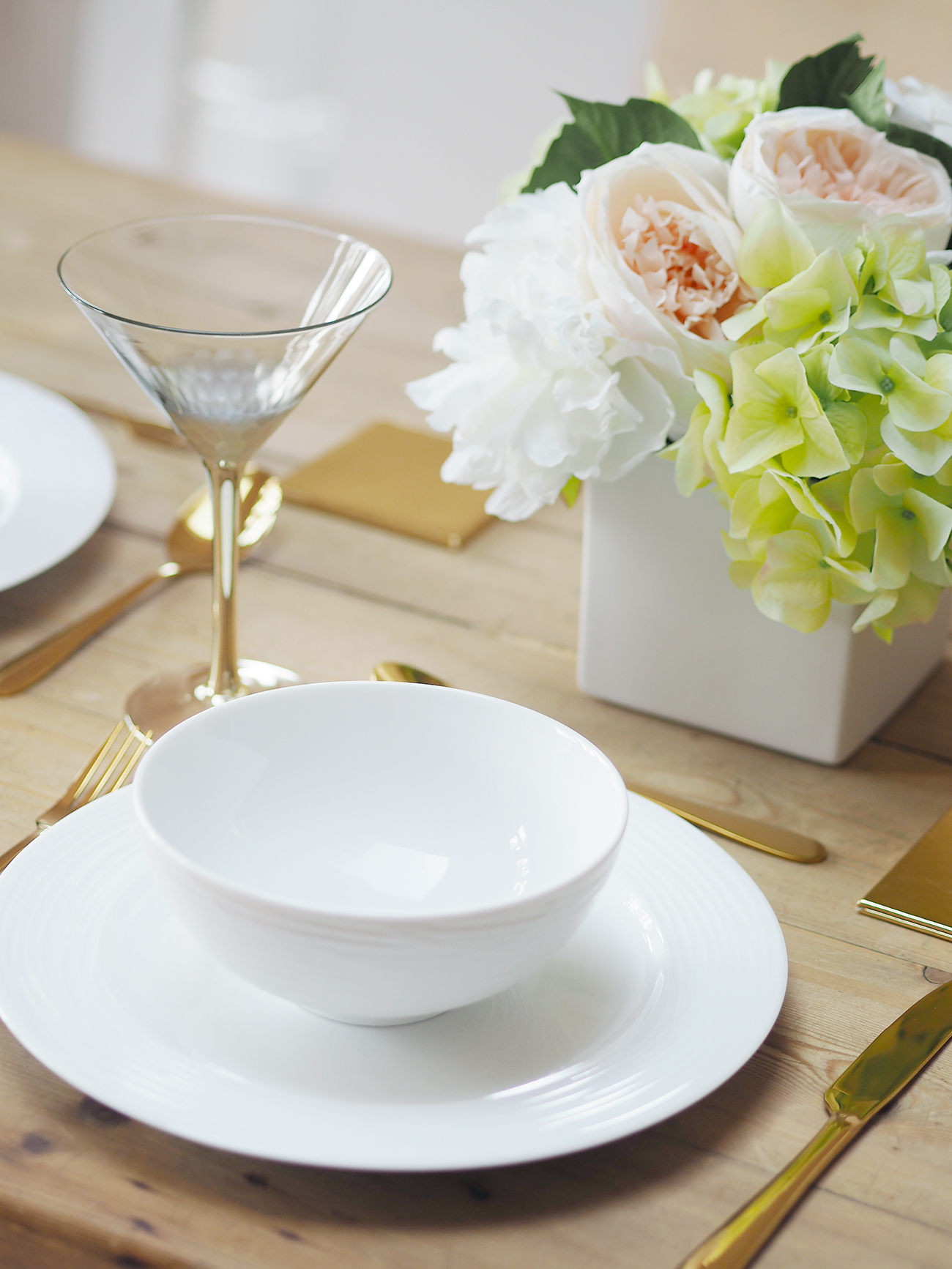 gold and white tableware gold cutlery