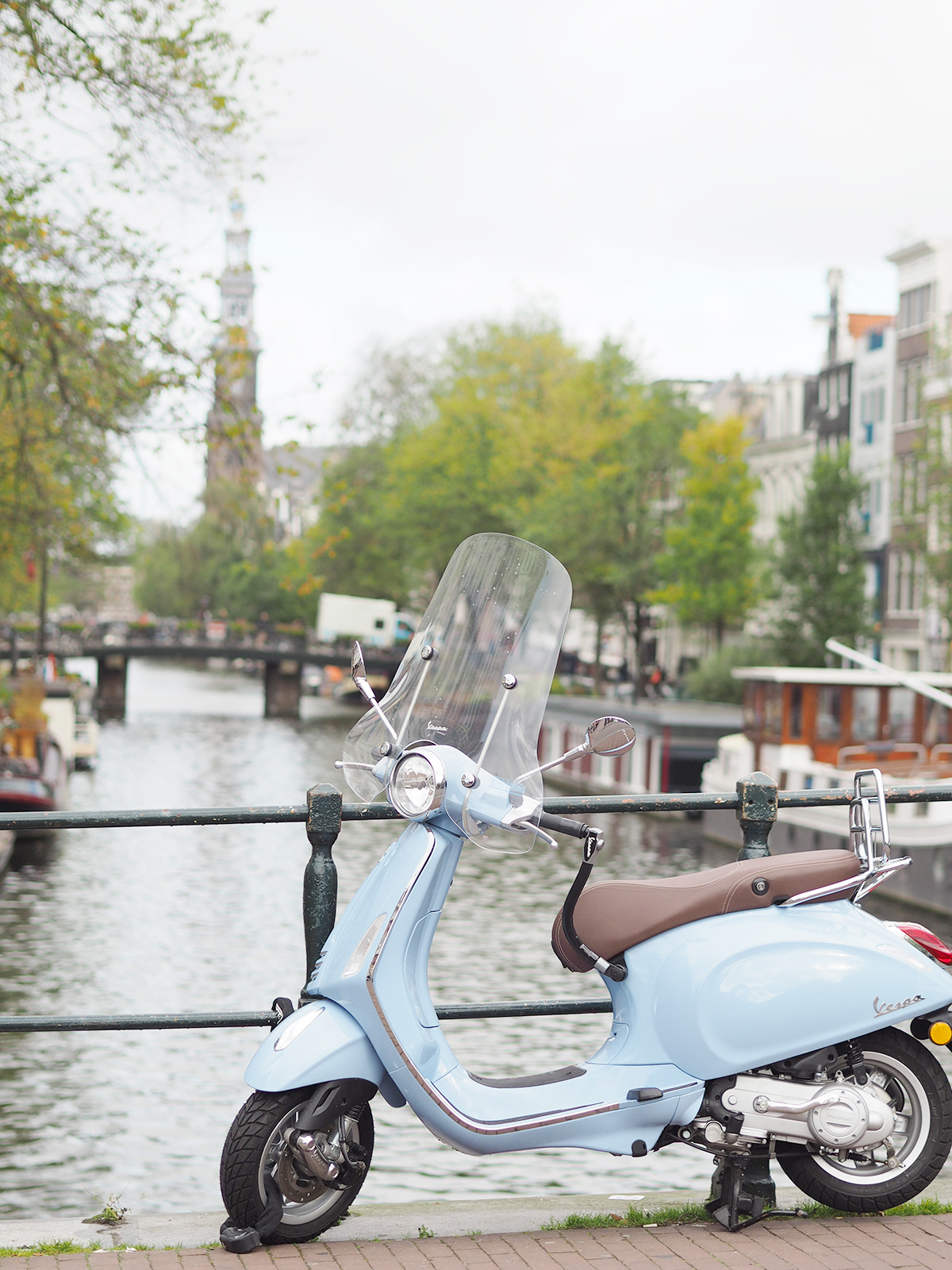 amsterdam bridge with blue scooter