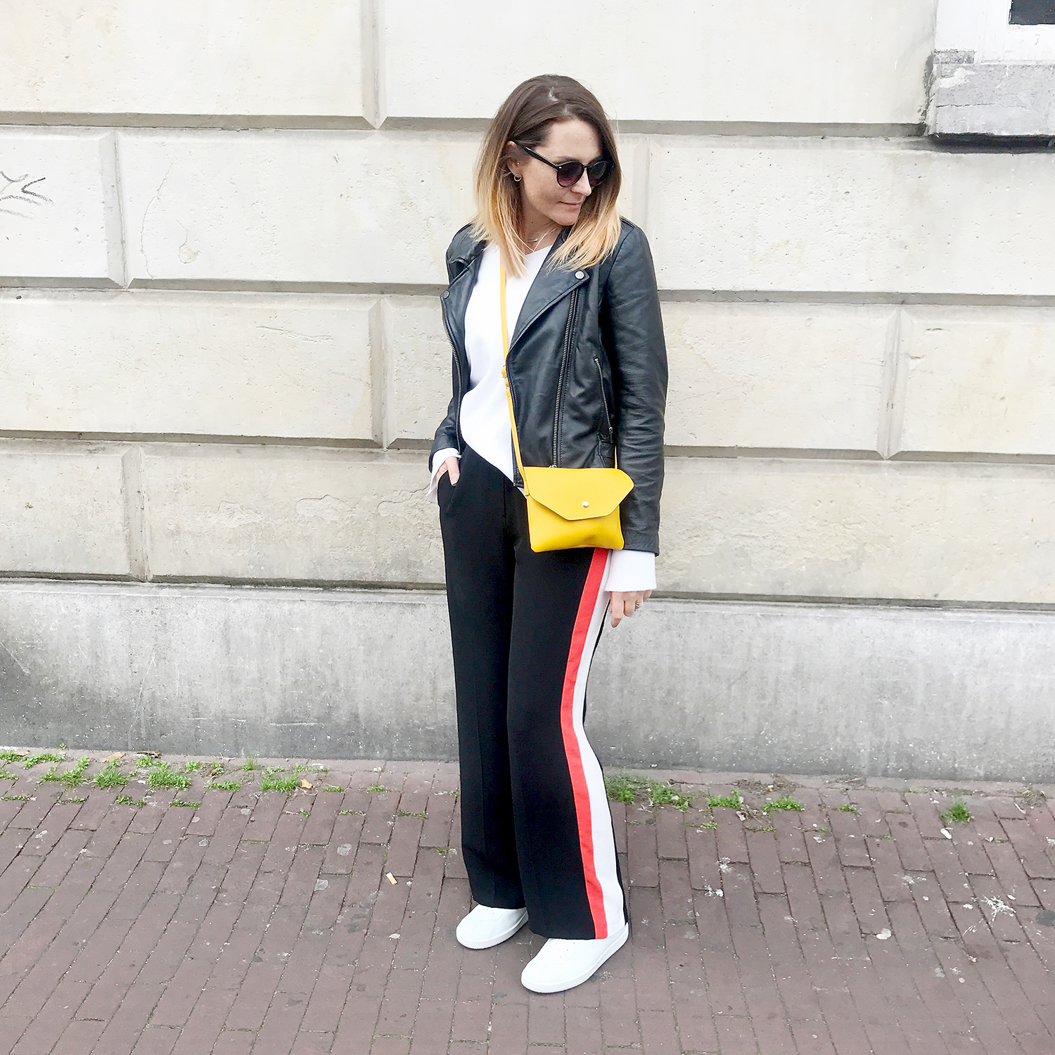 casual outfit striped wide leg trousers and biker jacket