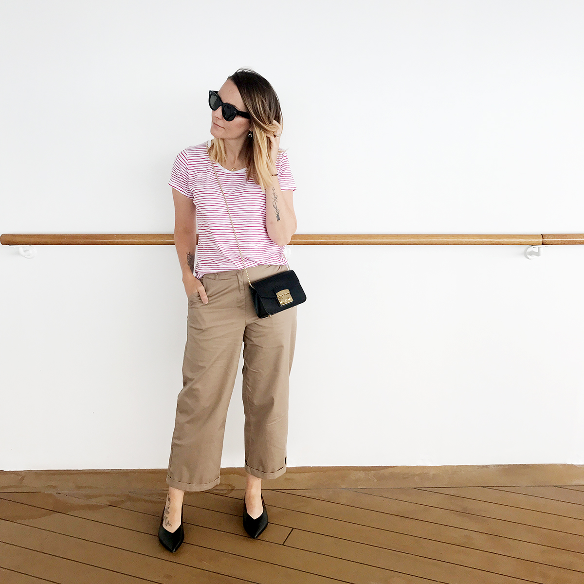 casual outfit tan trousers and striped tshirt