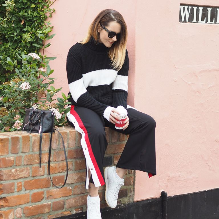 casual outfit with striped trousers and trainers