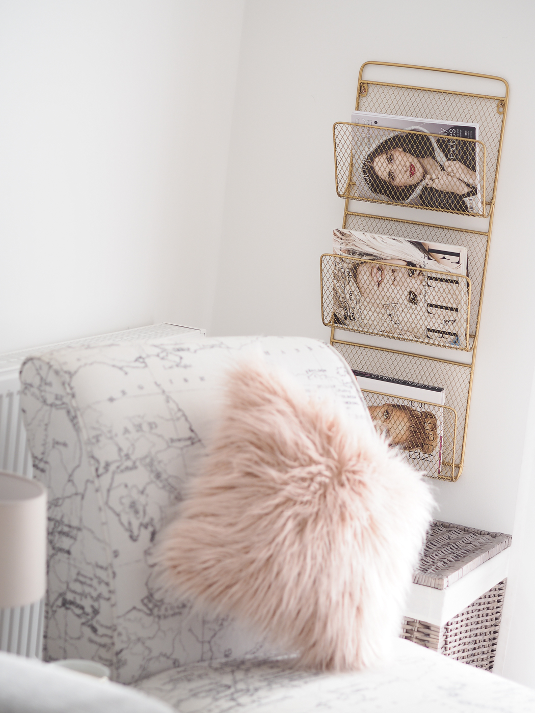 living room pink cushion and gold magazine rack