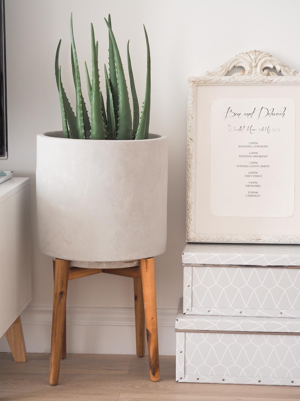 concrete planter on wooden legs