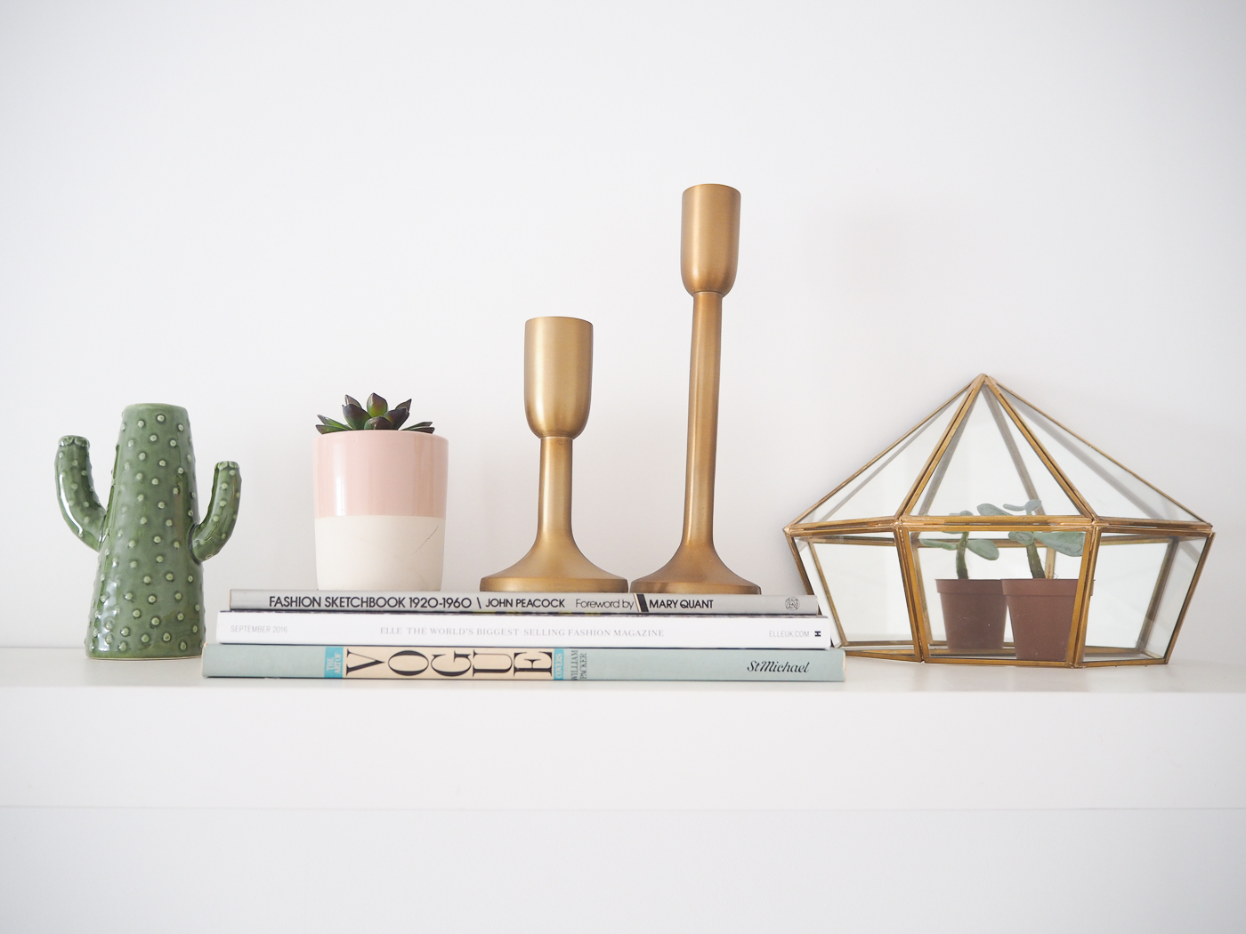 shelf with cactus vase and gold terrarium