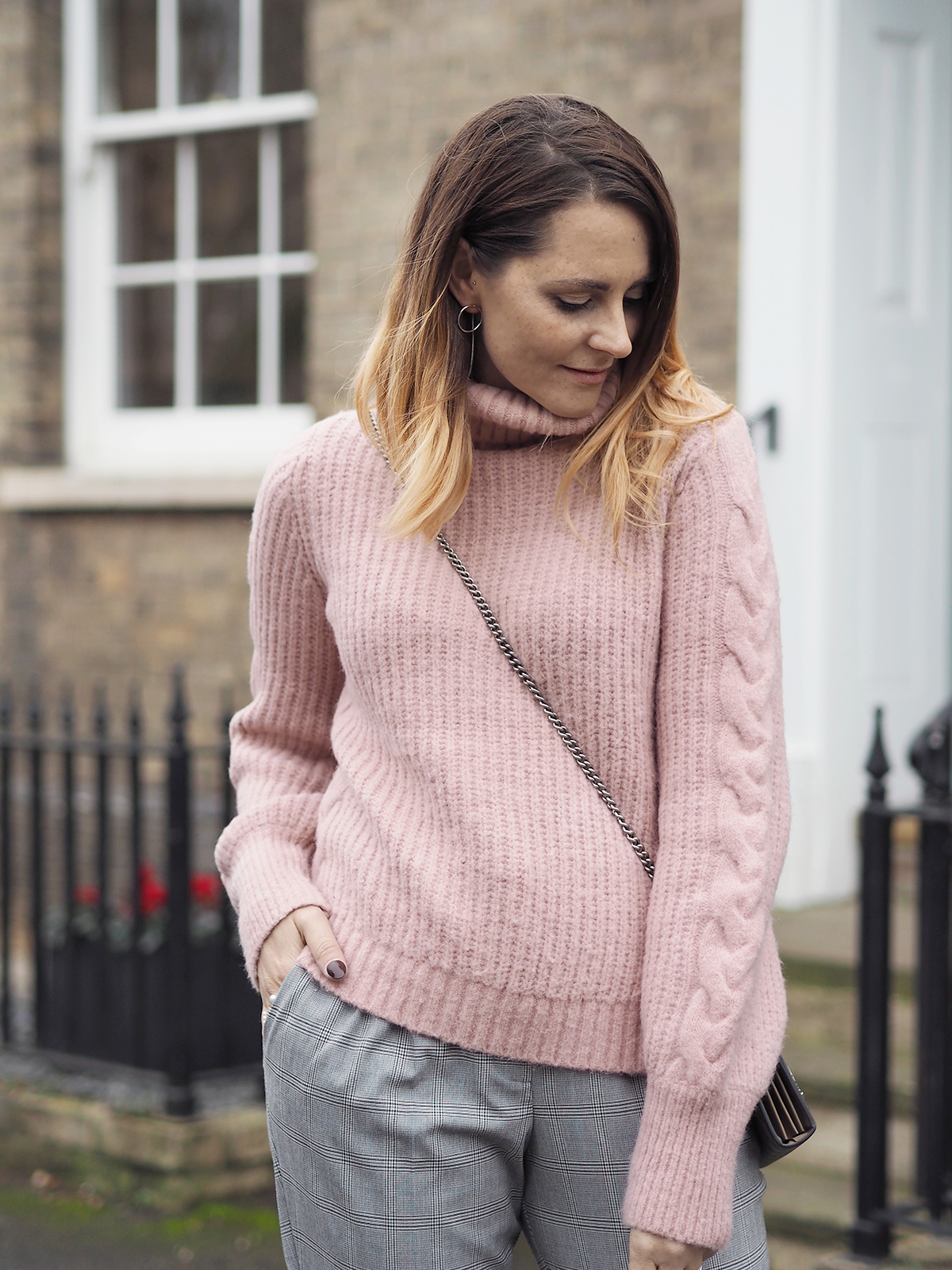 pink long coat and chunky pink jumper