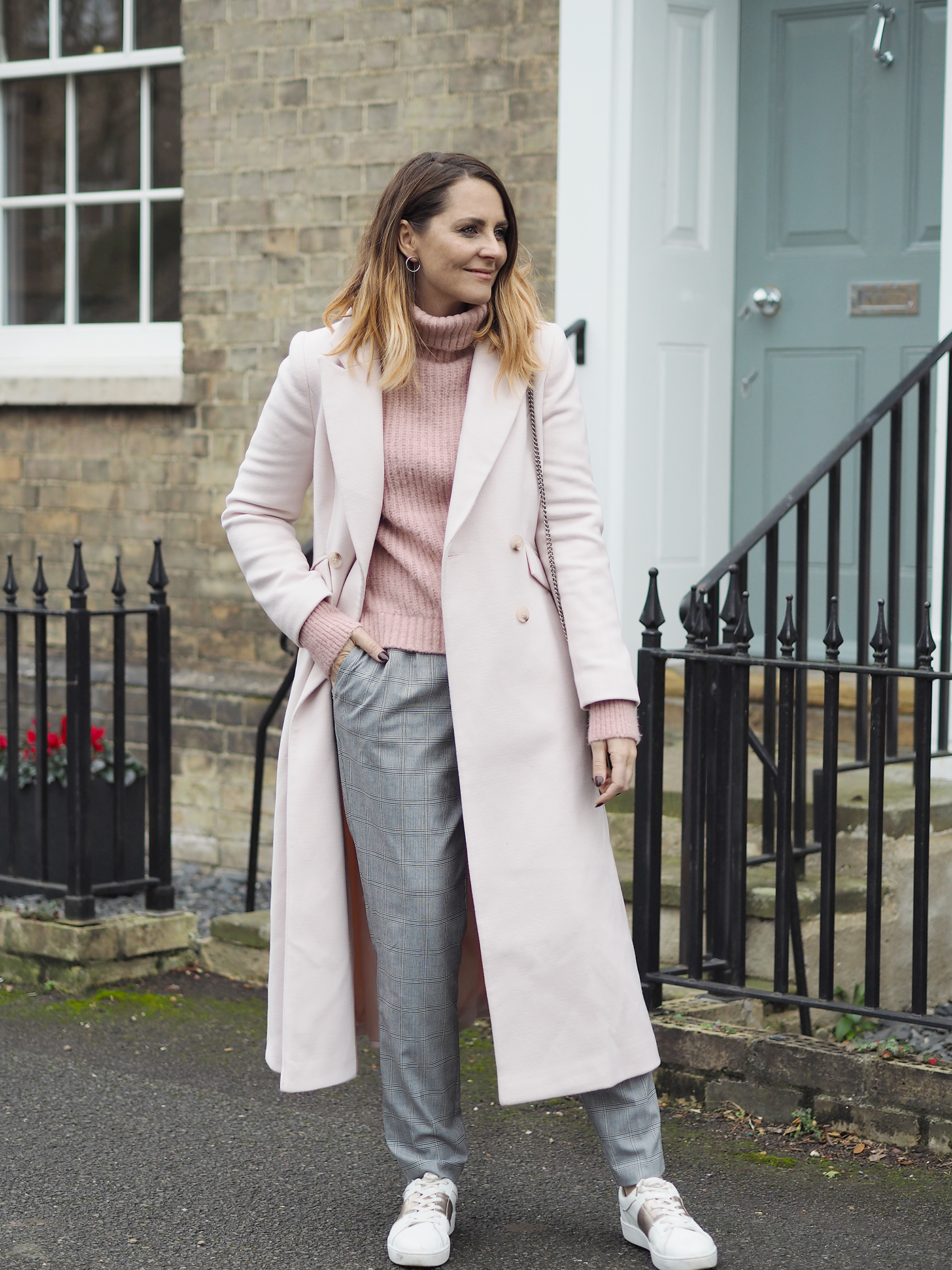 pink winter coat and pink jumper checked trousers outfit