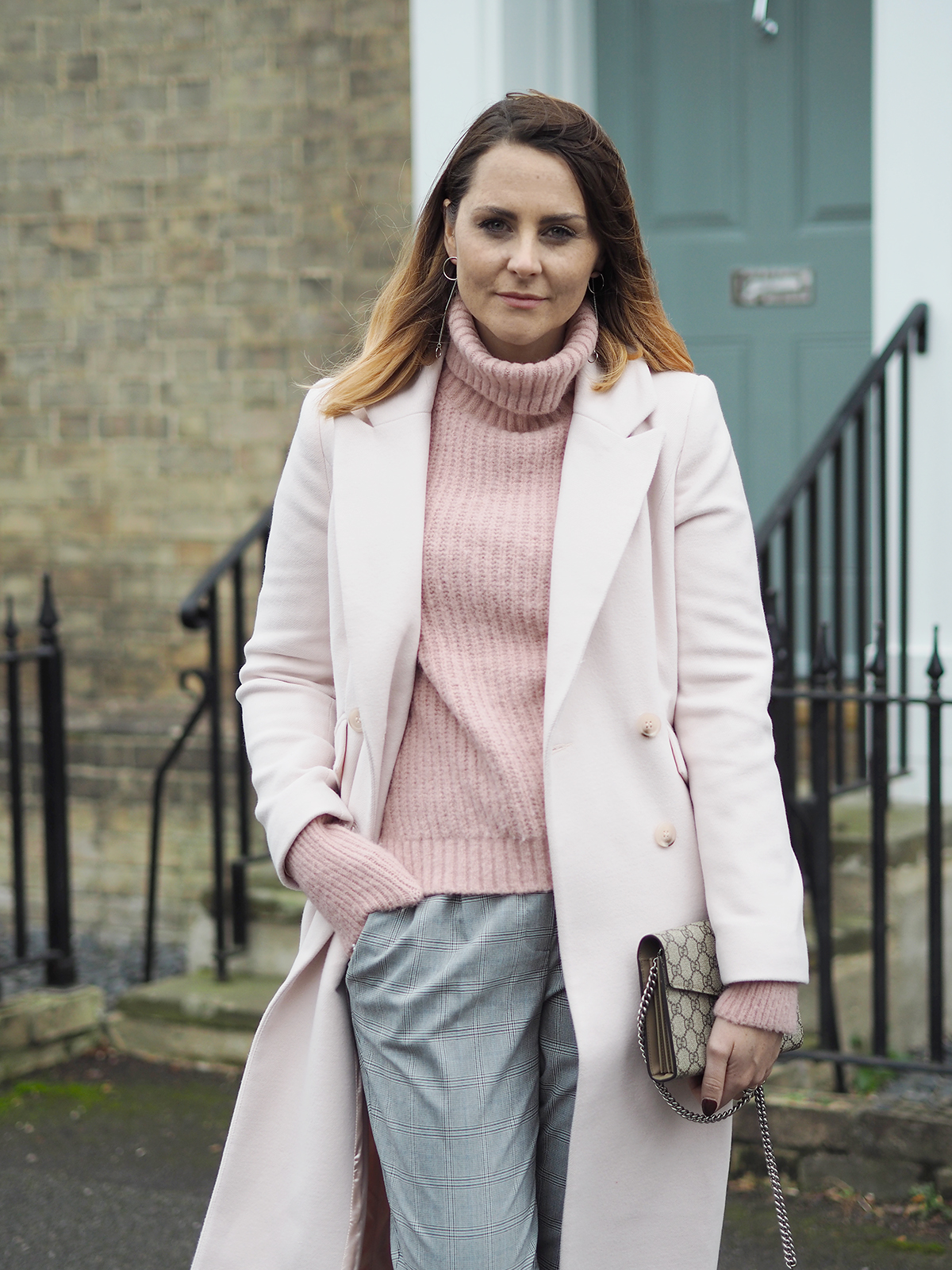 pink winter coat and pink jumper checked trousers outfit gucci dionysus