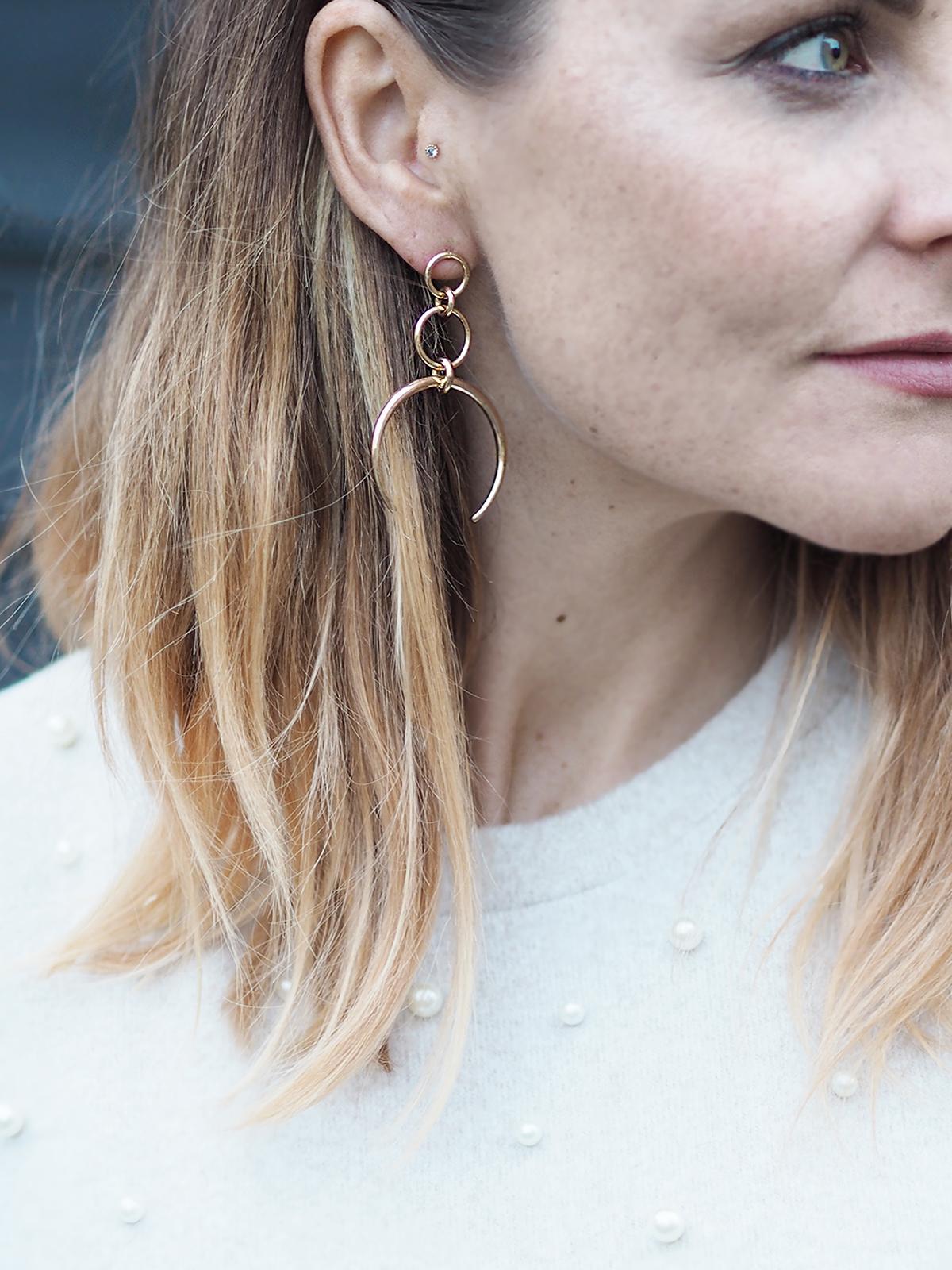 large gold horn earrings