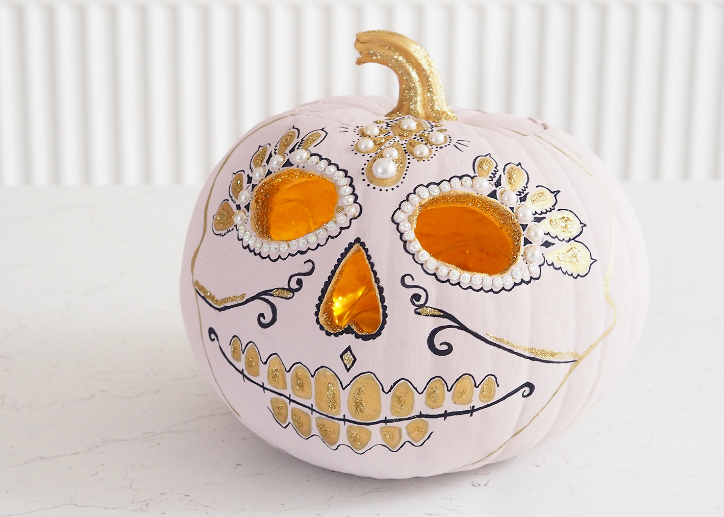 pink and gold halloween pumpkin skull