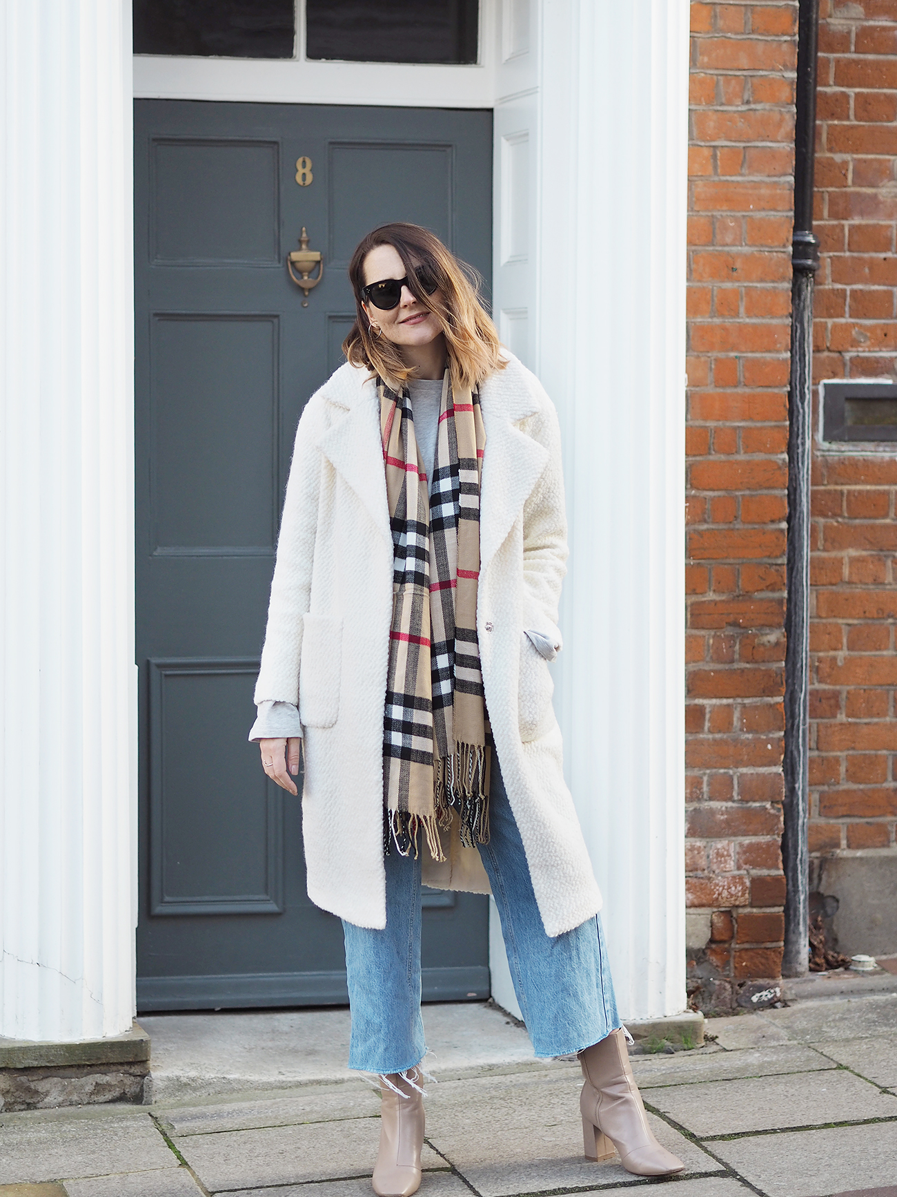 cream coat and Burberry check scarf outfit with jeans
