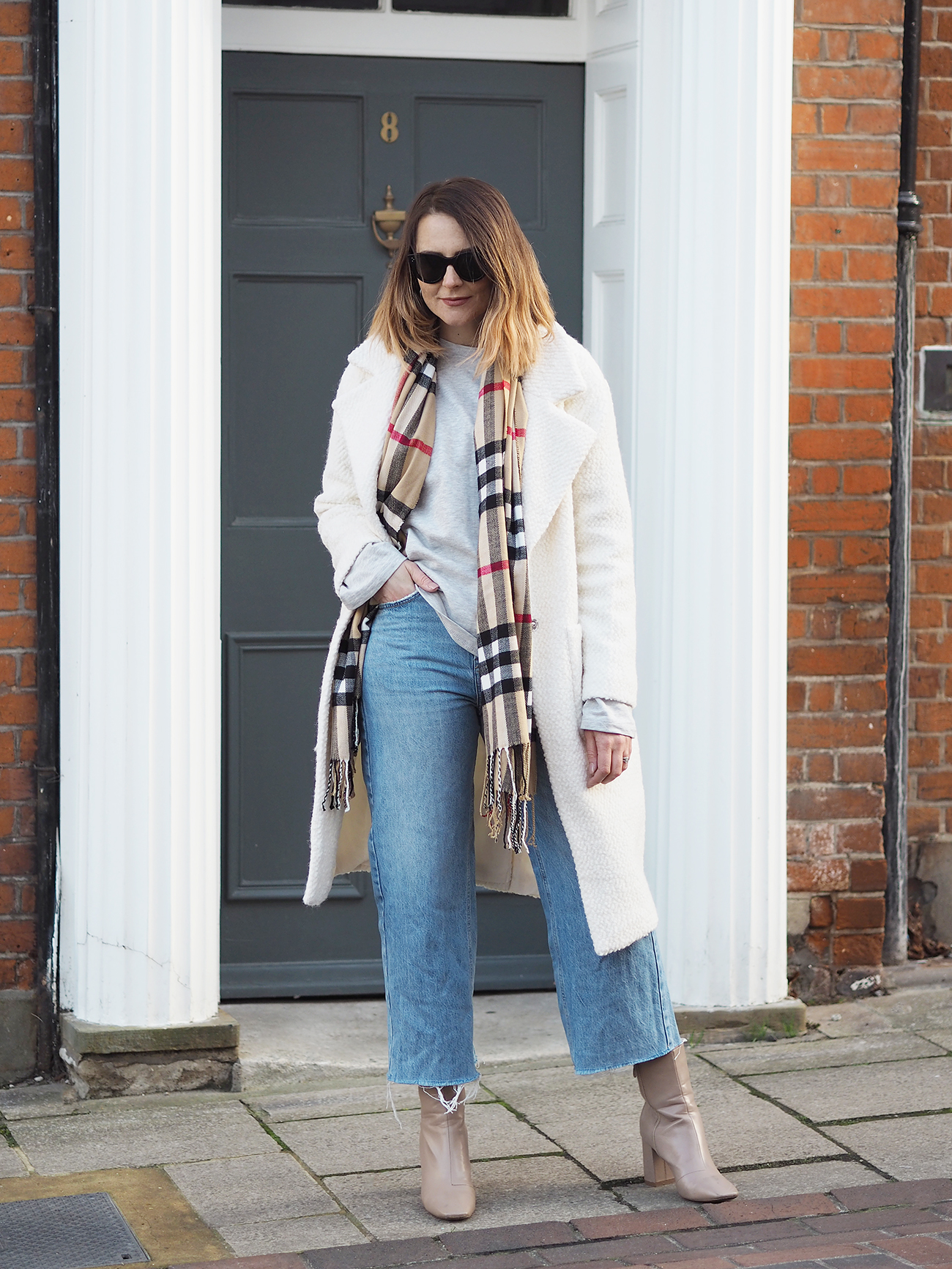 cream coat and burberry scarf outfit with jeans