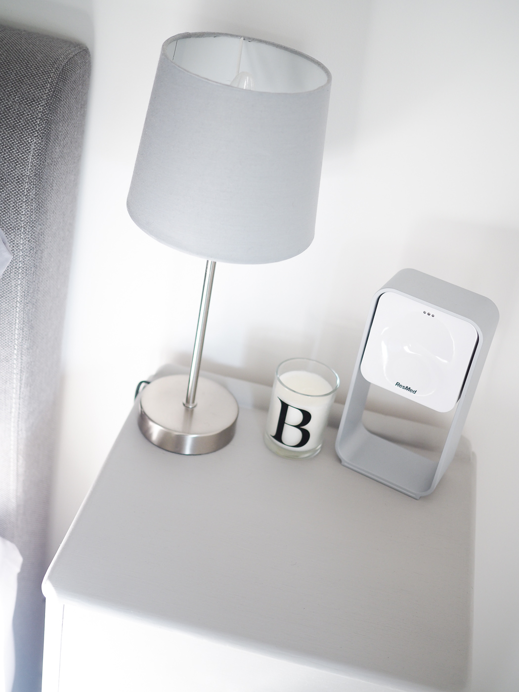 painted grey bedside table with crystal handle