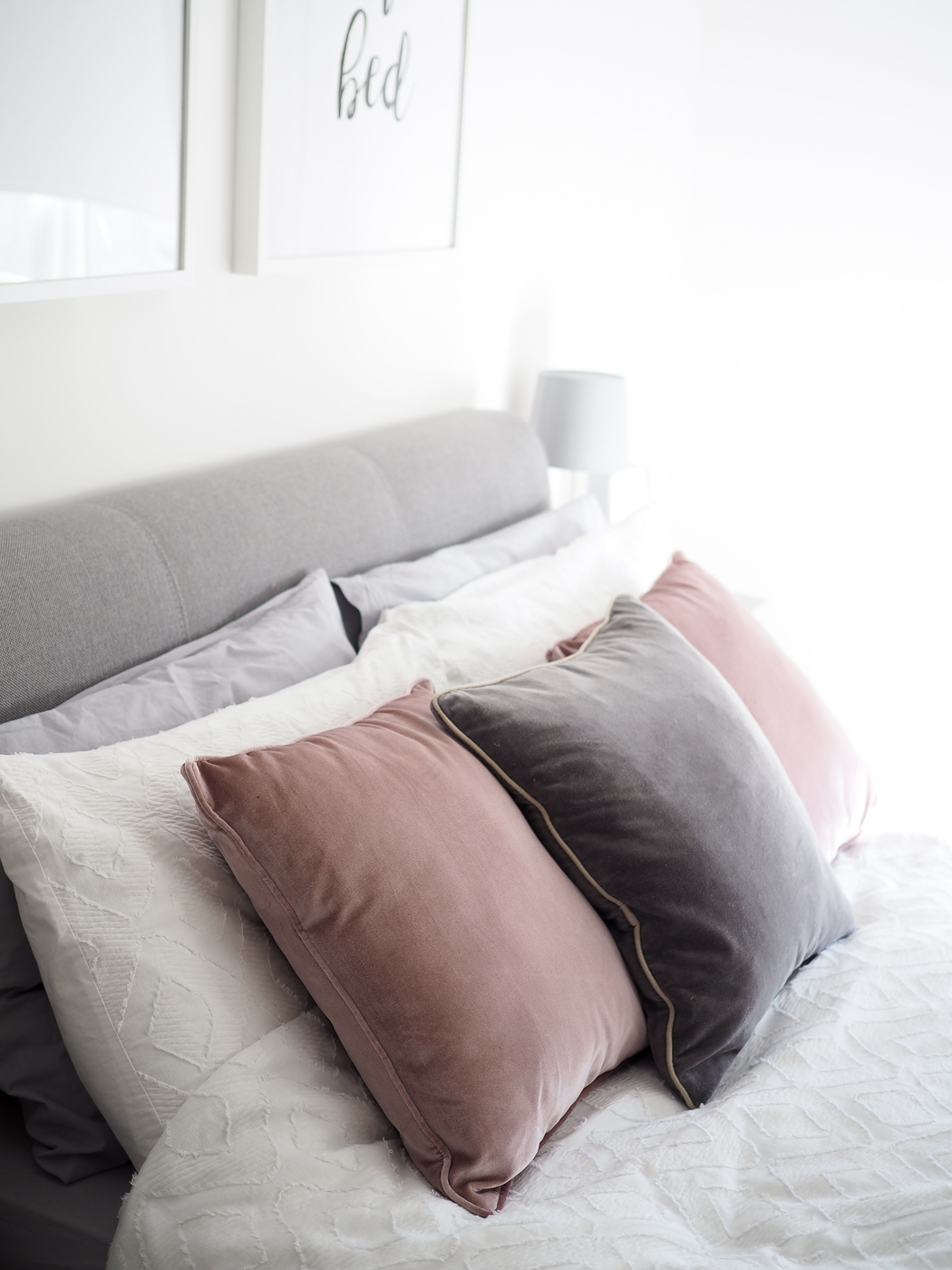 scanid bedroom pink and grey cushions on bed white duvet