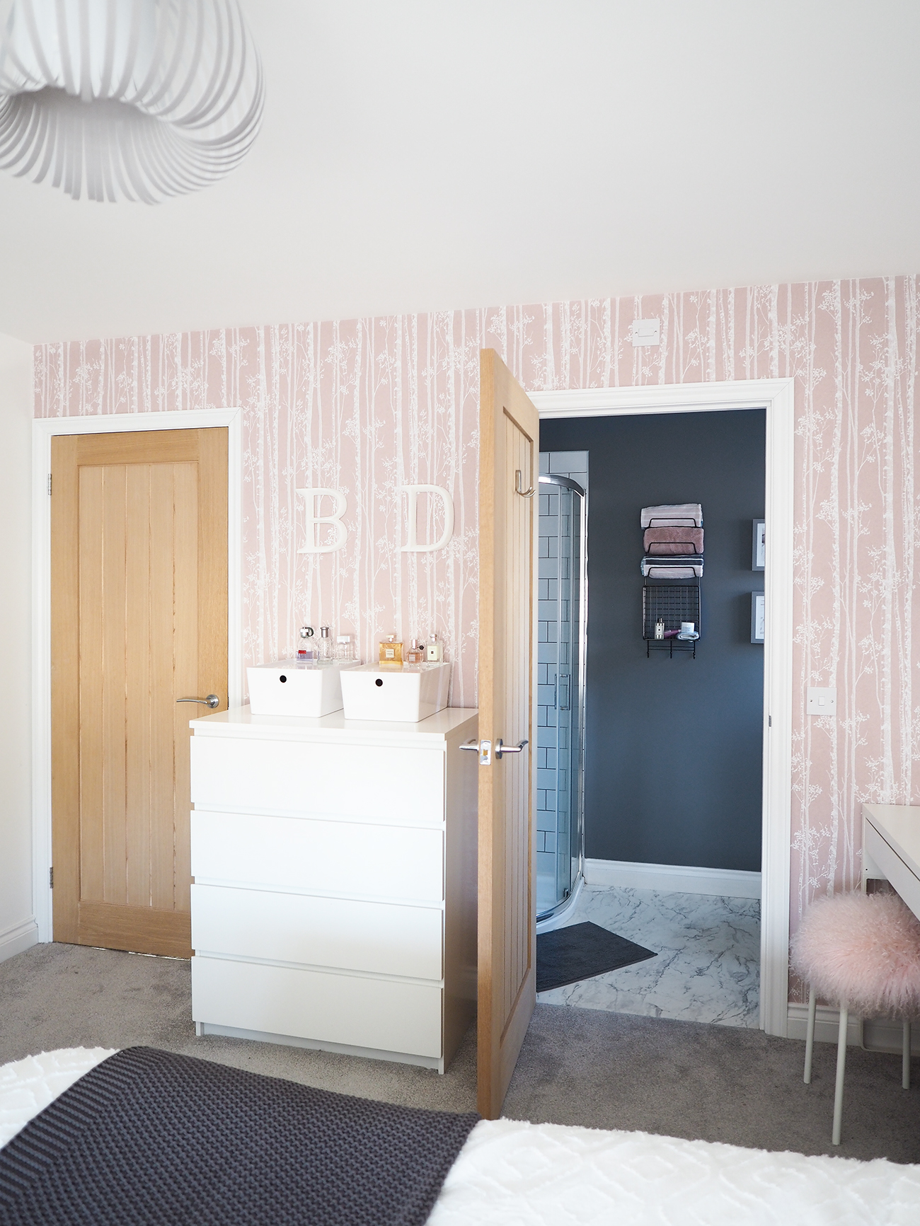 pink and grey scandi bedroom with wallpaper feature wall