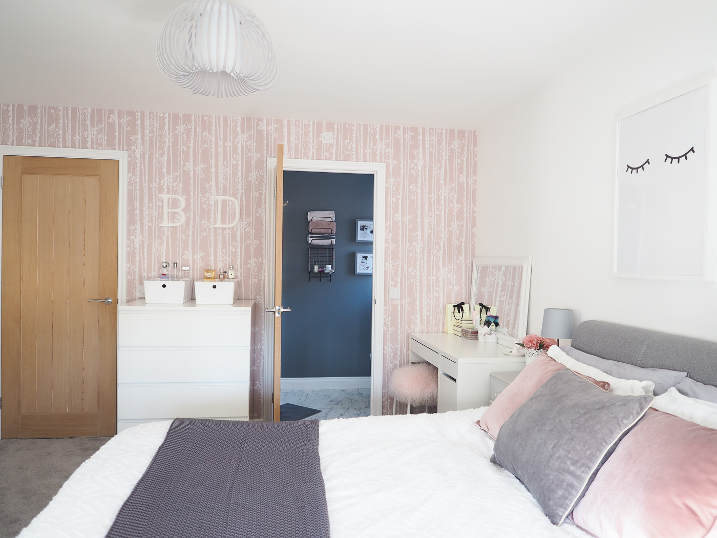 grey and pink bedroom with pink wallpaper