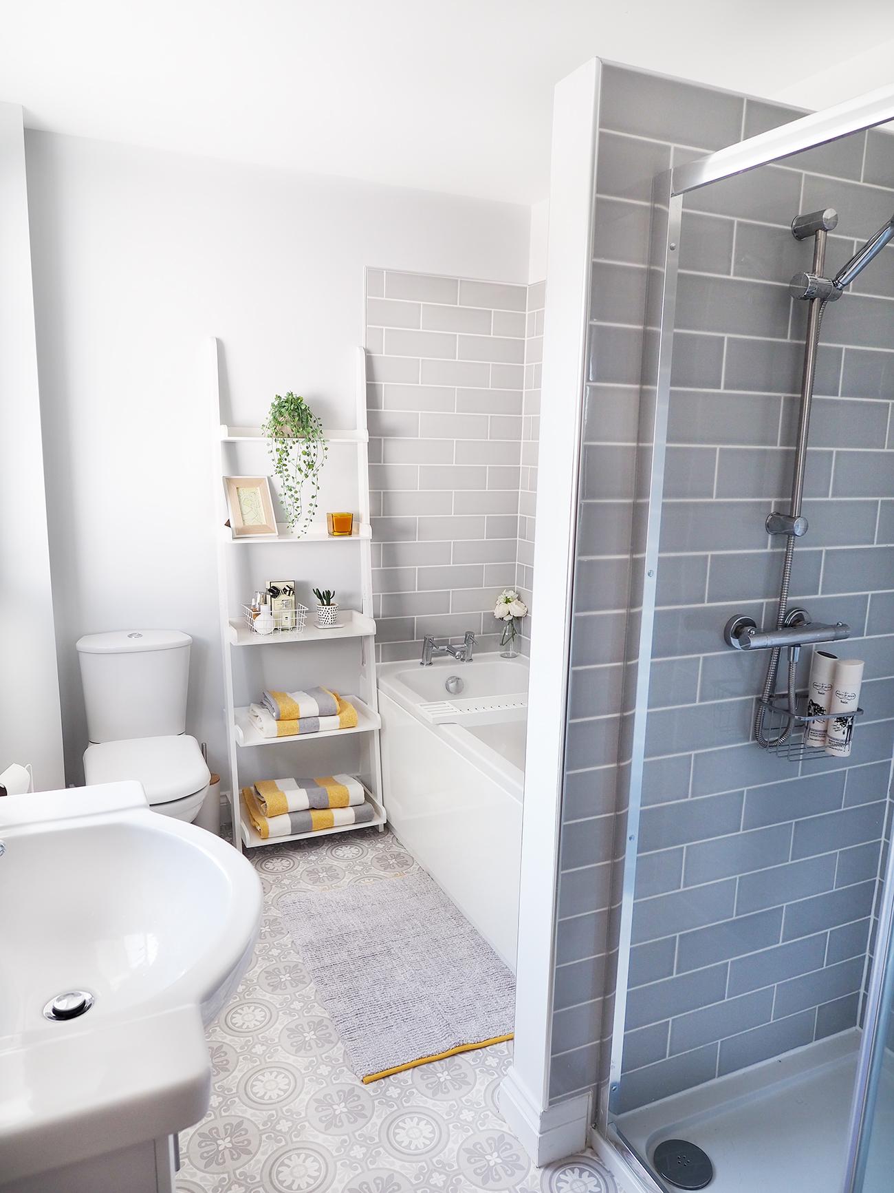 grey subway tiled bathroom