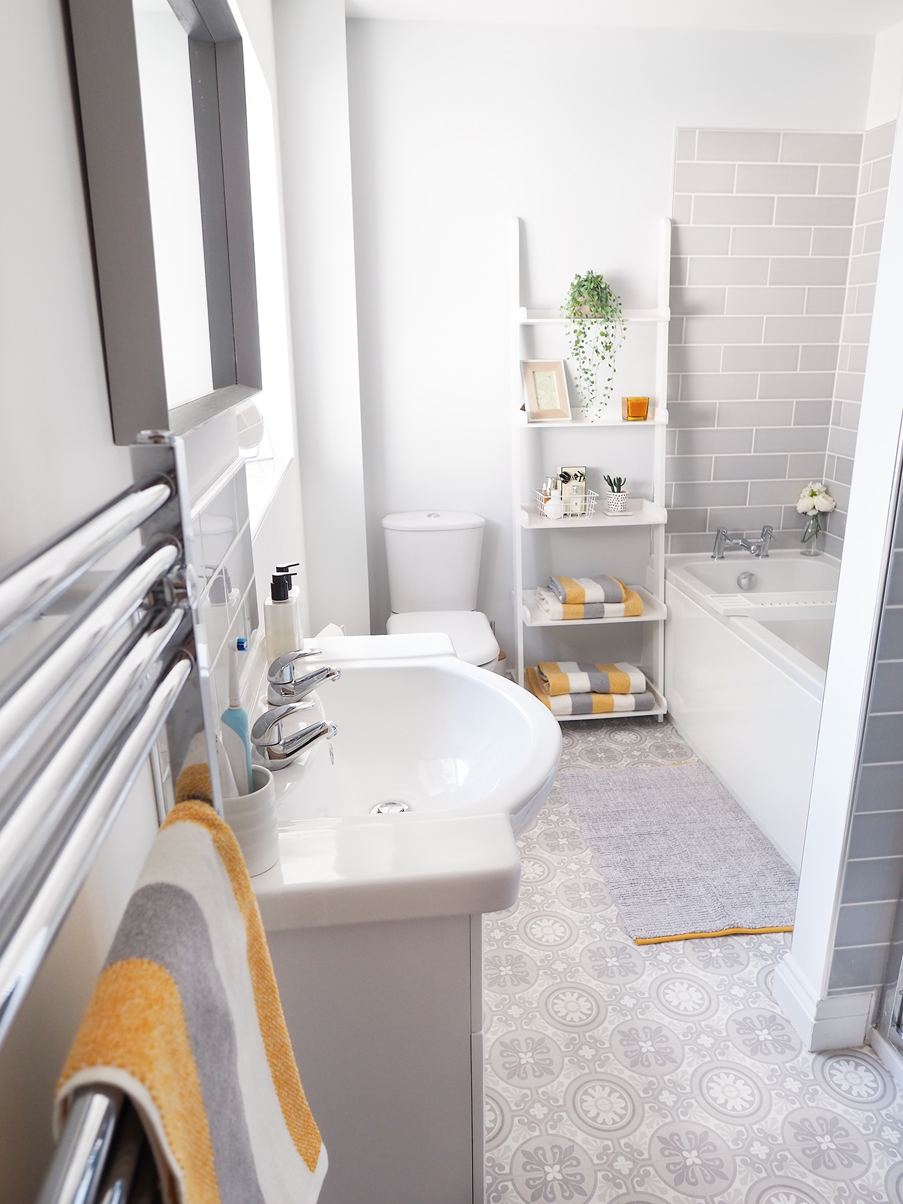bathroom makeover grey white and yellow