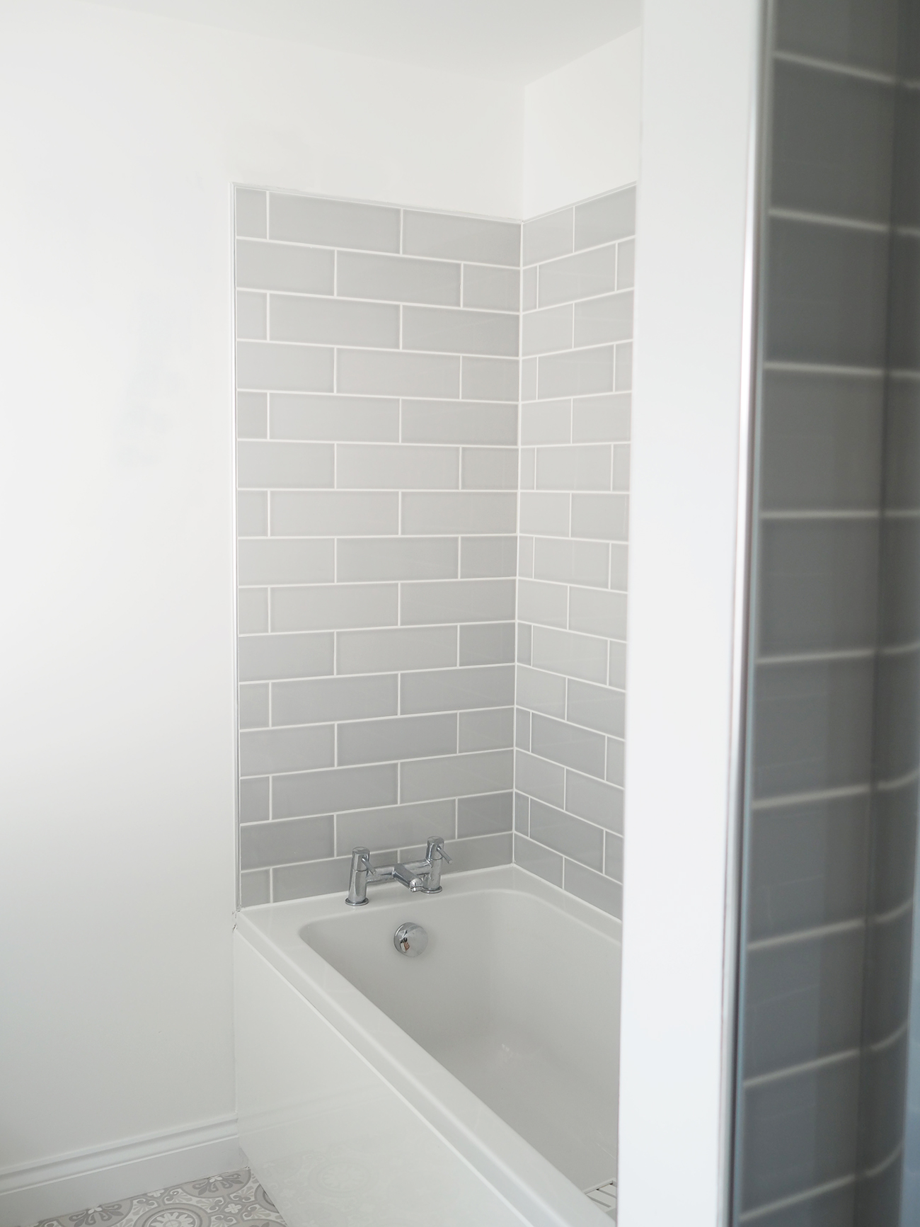 grey subway tiled bathroom