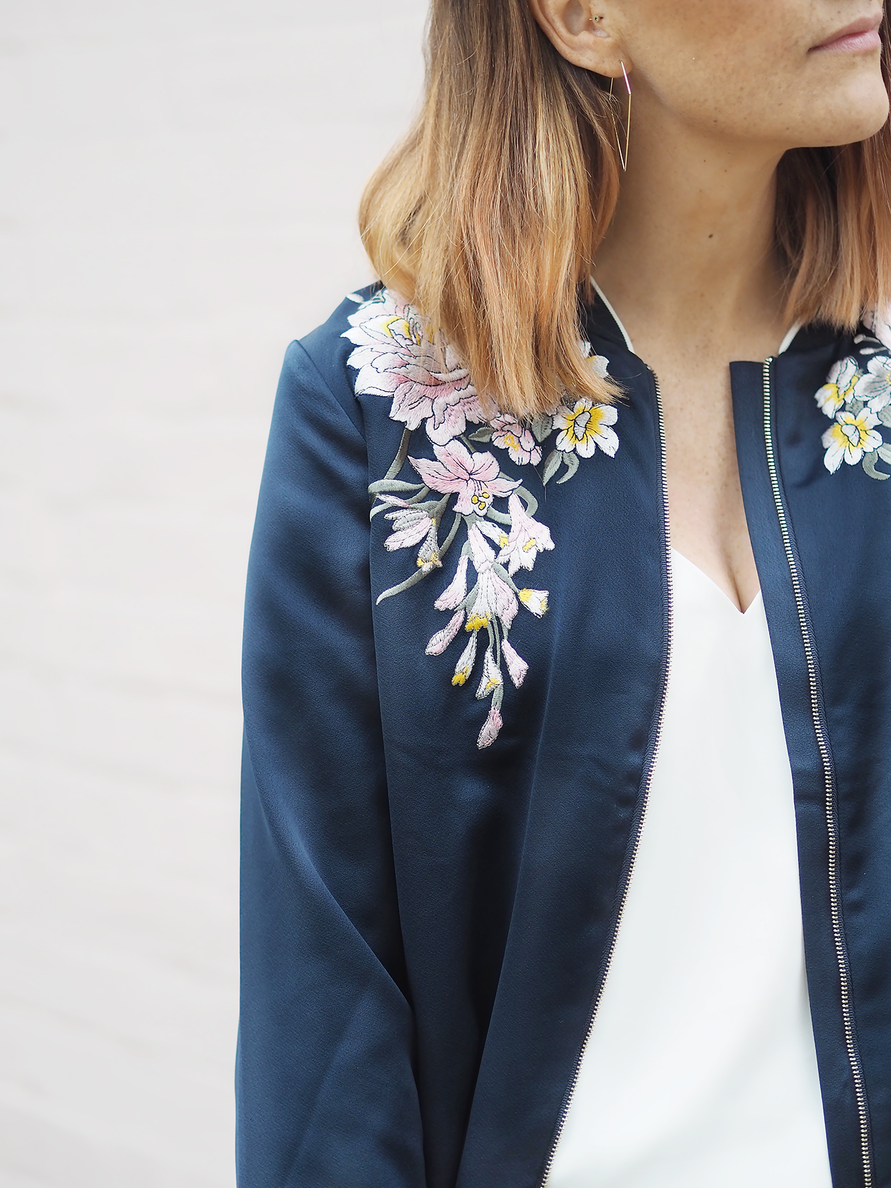 floral bomber jacket and joggers outfit