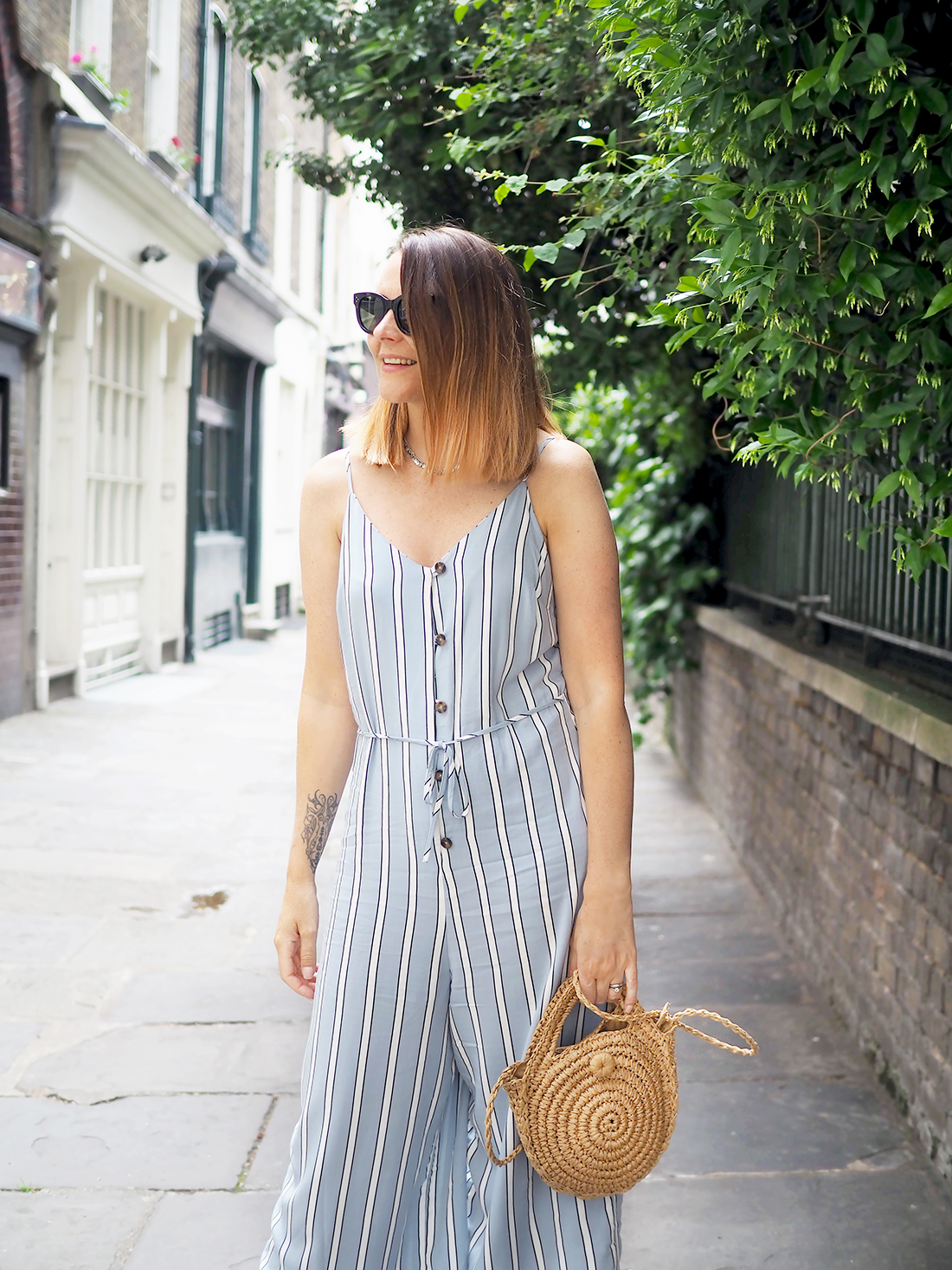primark jumpsuit outfit with denim jacket and white trainers