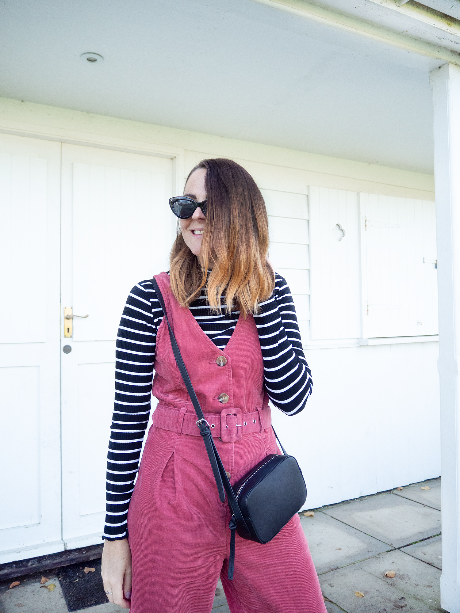pink jumpsuit with sriped top underneath
